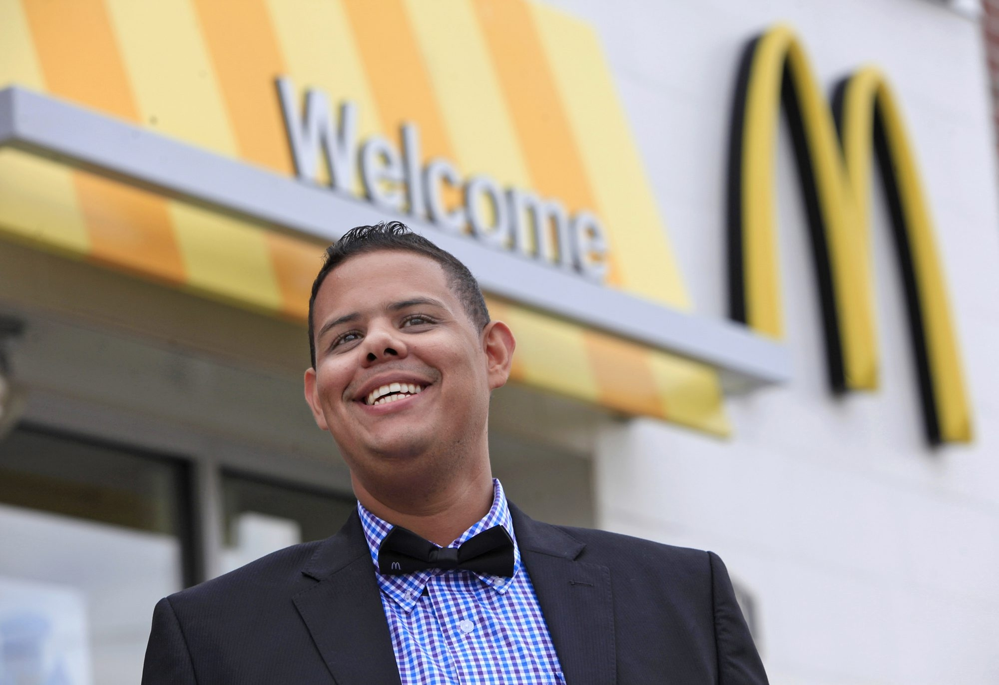 McDonald's area manager Jose Munoz of Paterson, N.J., taught himself English by watching TV, impressing his bosses.