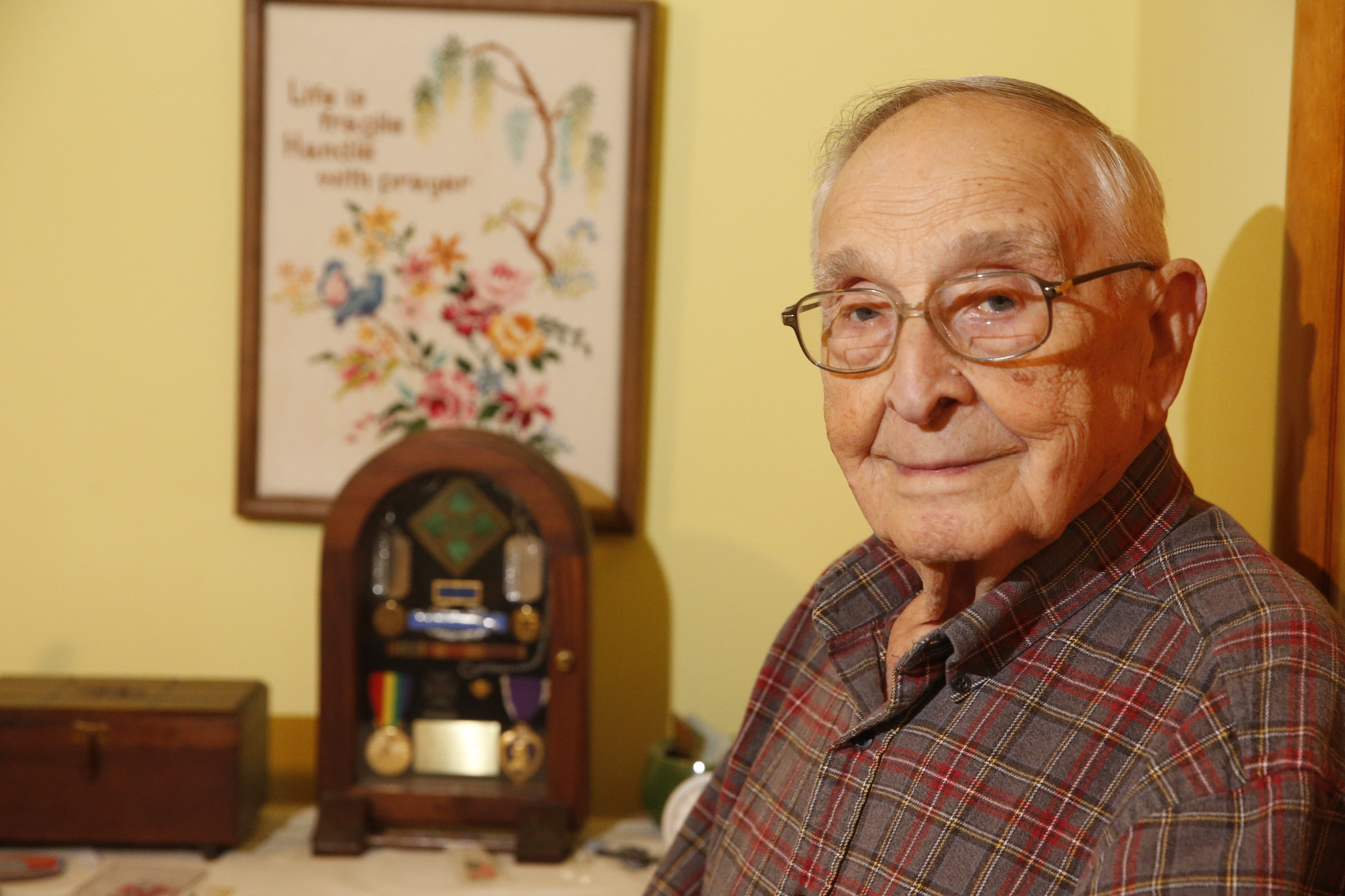 Alvin Hardy, at home in Amherst, recalls Normandy and, two weeks later, Cherbourg, where he got hit by shrapnel.