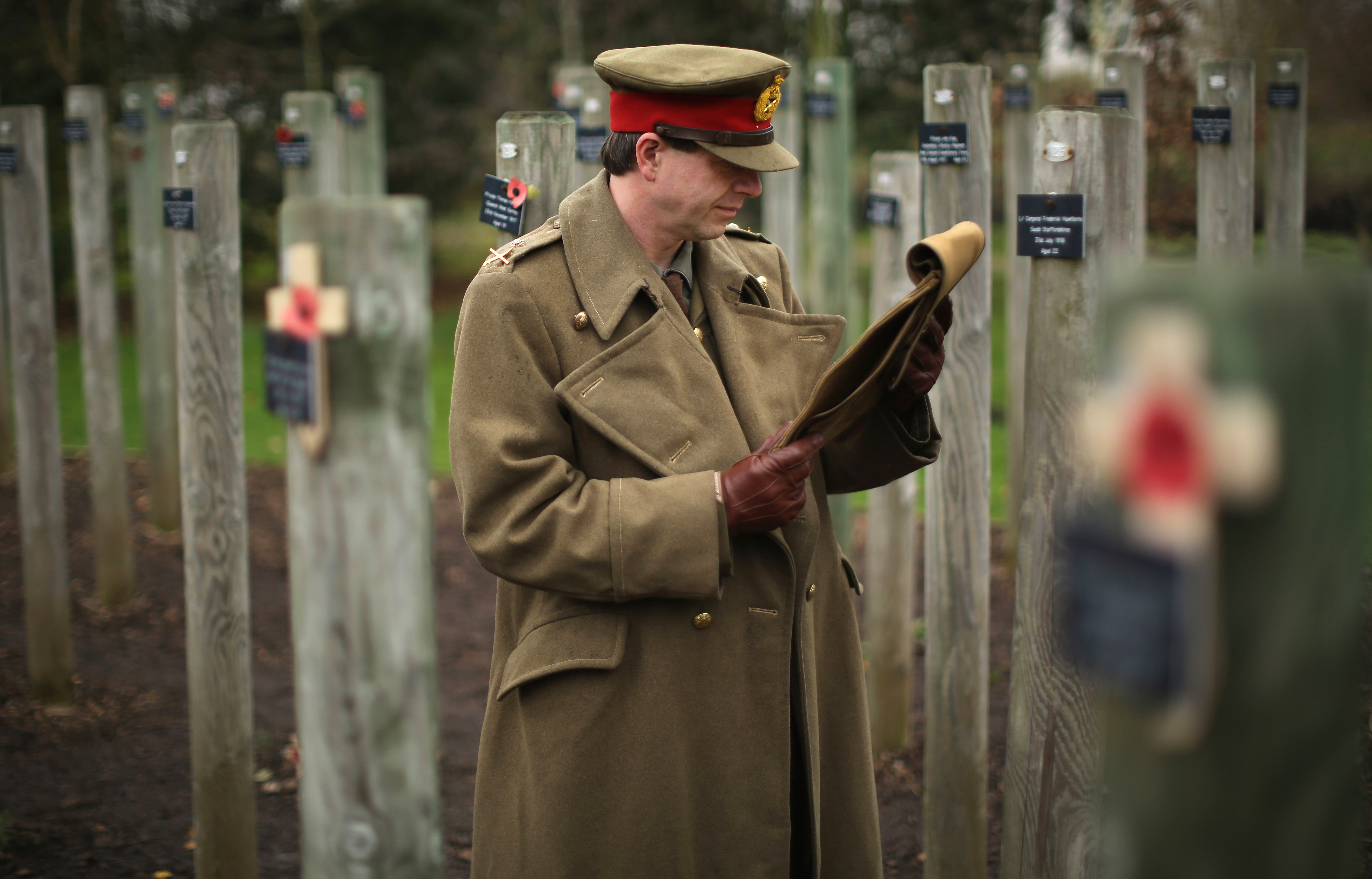 Living historian Paul Thompson poses as Gen. Walter Congreve V.C. at the National Memorial Arboretum in Staffordshire, England, this month as he reads the general's letter from the trenches describing the Christmas Day Truce of 1914. The previously unpublished letter, donated by the general's family to the Staffordshire Council archives, tells how British and German soldiers agreed to the famous truce in no man's land, where they sang songs and played soccer before returning to their trenches.