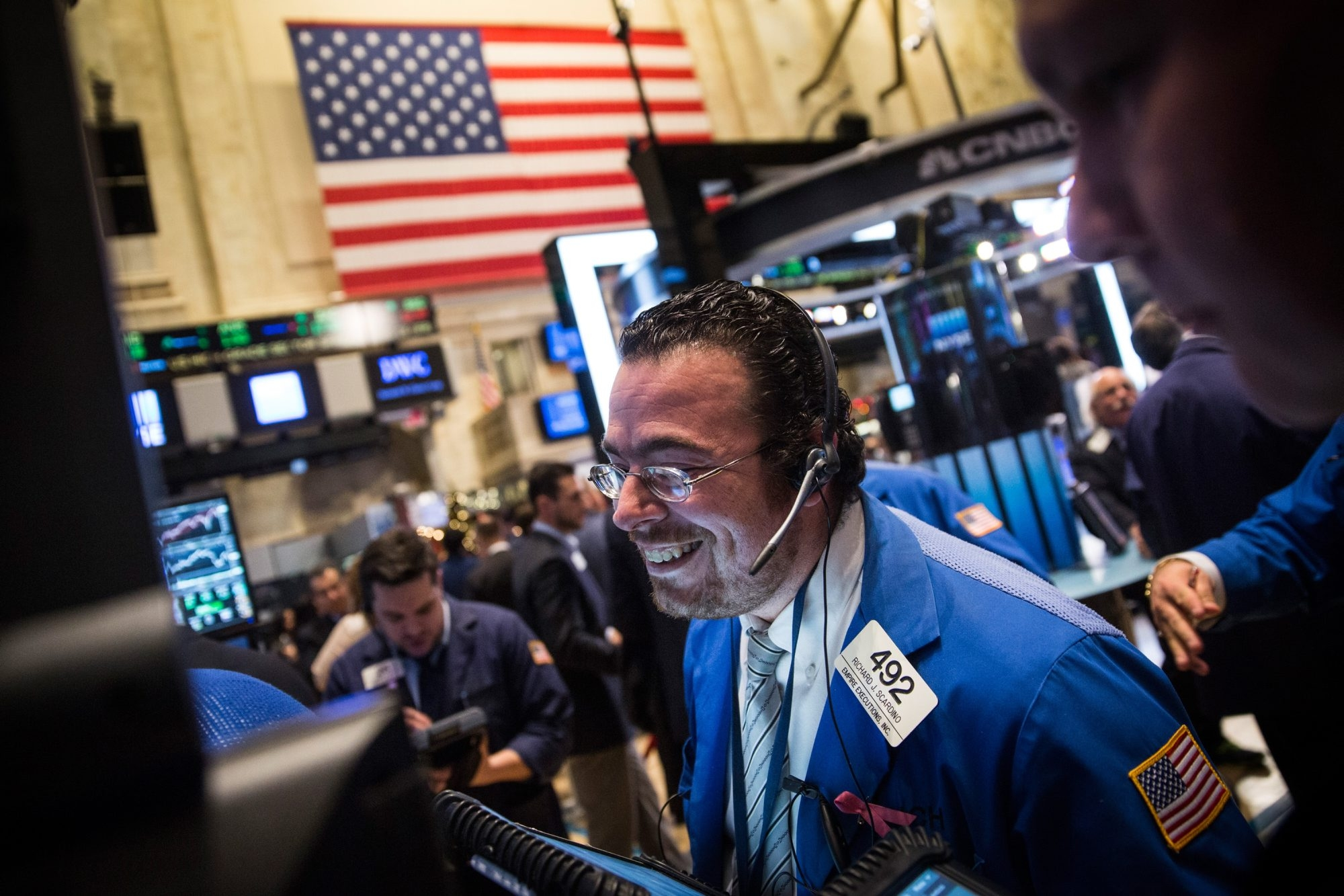 Traders work on the floor of the New York Stock Exchange Thursday afternoon in New York City. The stock market rose on Friday, sending the Standard & Poor's 500 Index near it's all-time high and erasing December's losses.