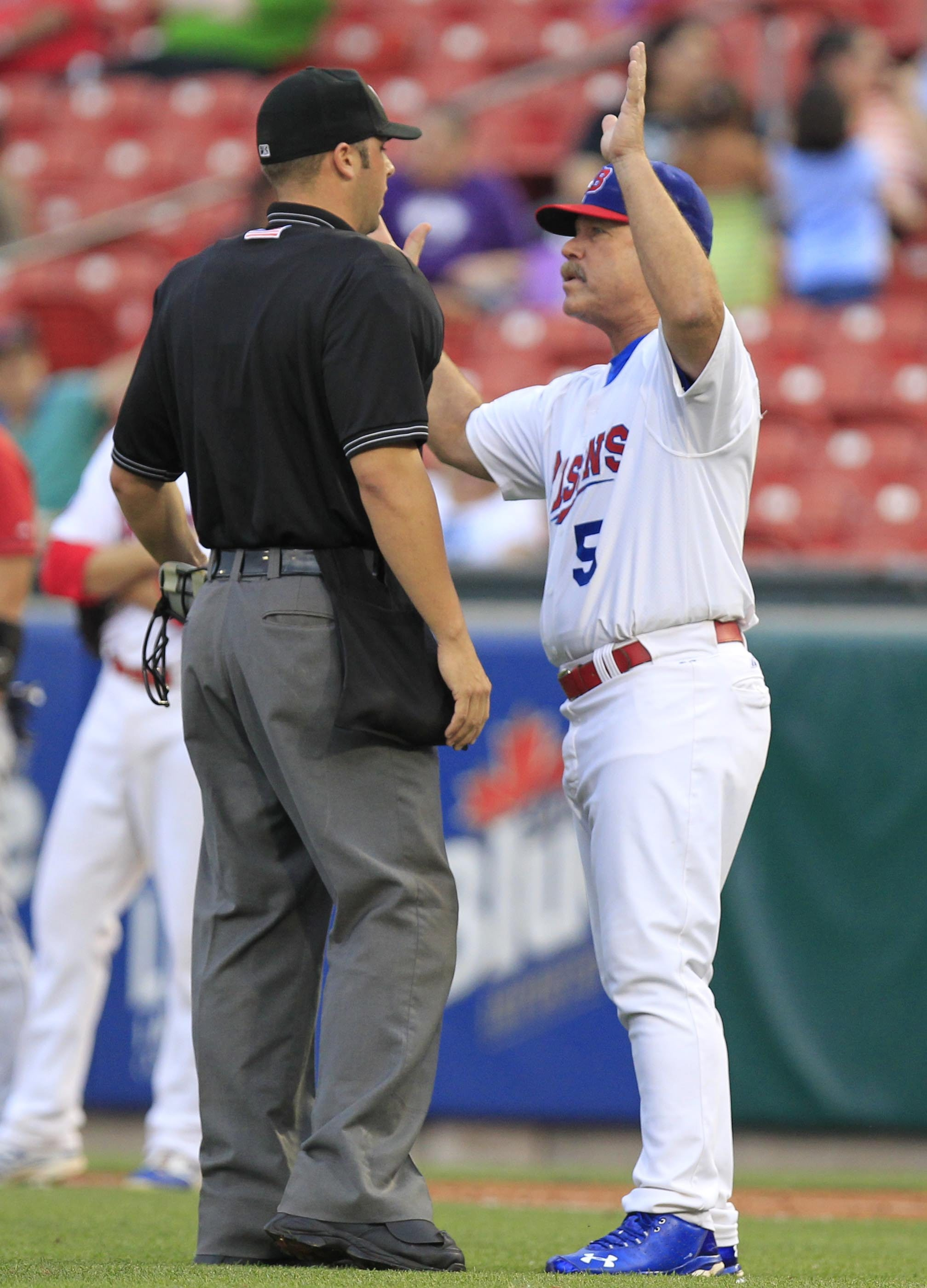 Buffalo Bisons manager Gary Allenson argues with Home plate umpire Dave Soucy, that a Columbus Clippers player interfered on a double play attempt during third inning action at Coca-Cola Field on Tuesday, June 24, 2014. (Harry Scull Jr. /Buffalo News)