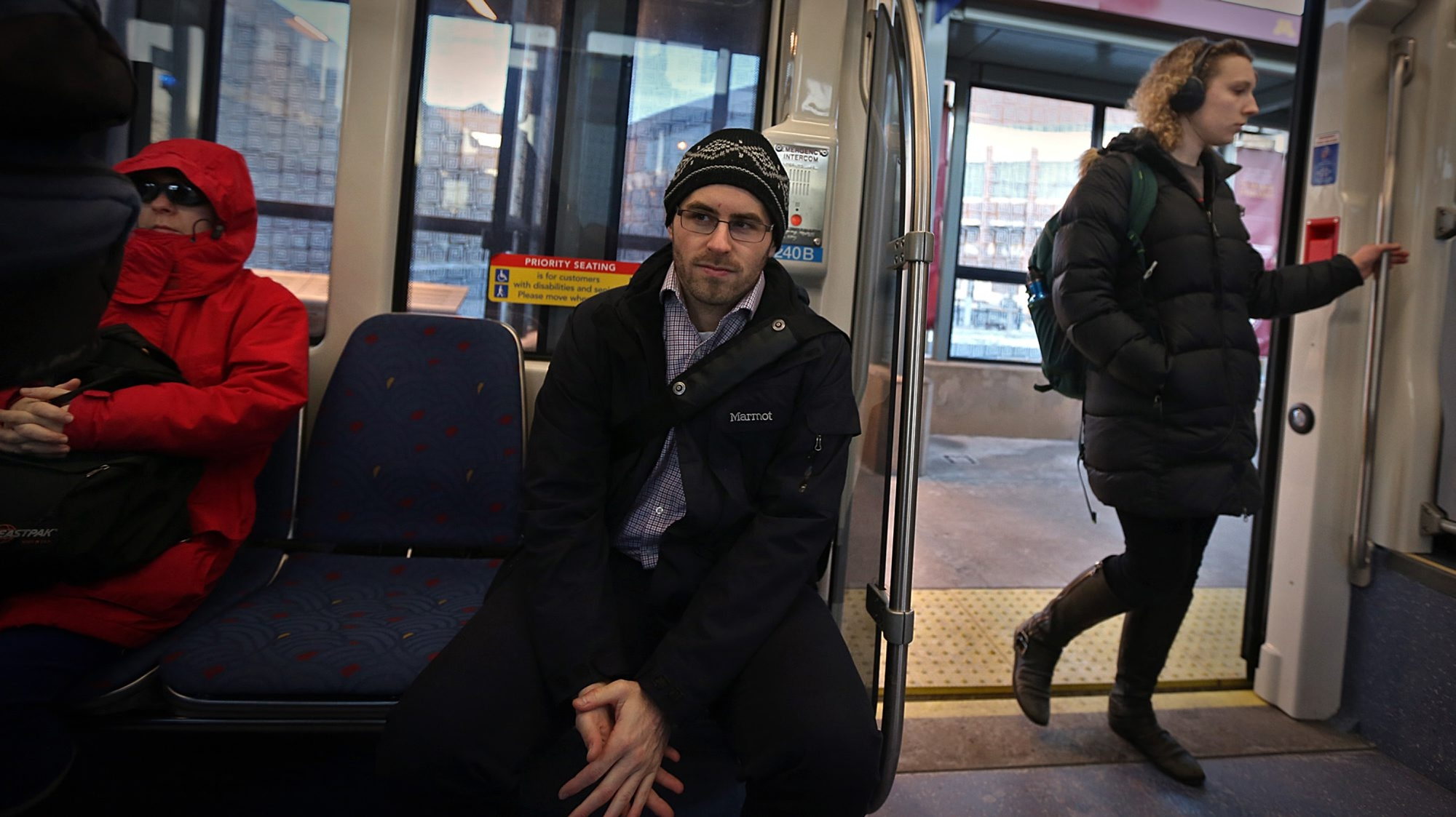 Jonathan Reiner and his girlfriend Emma Fazio, not pictured, are multi-modal millennial commuters. They board the Green Line every day -- she heads to St. Paul, and he goes to Minneapolis. (Jim Gehrz/Minneapolis Star Tribune/TNS)