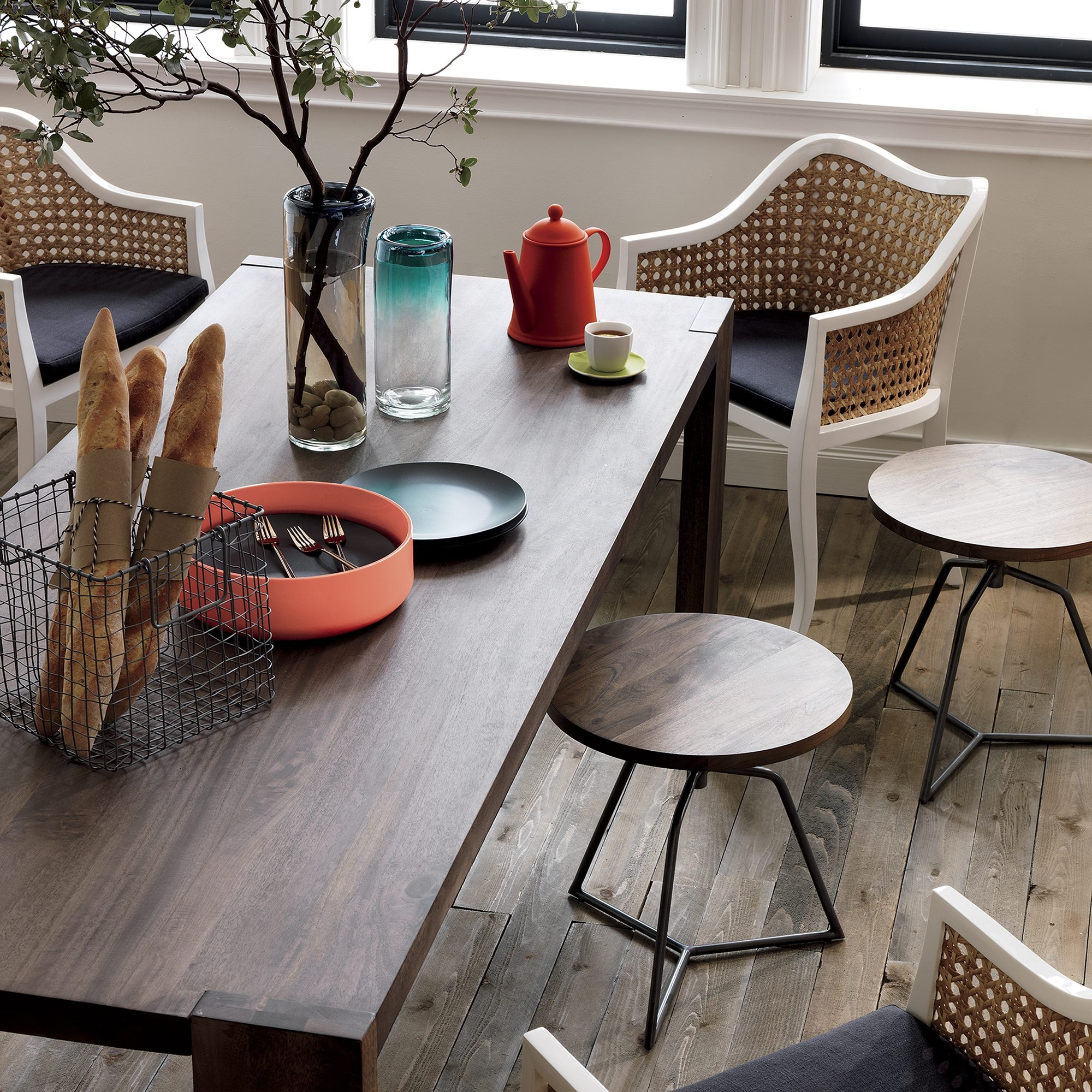 A black cushion adds even more style and comfort to the Tabayas cane side chair by CB2, www.cb2.com.