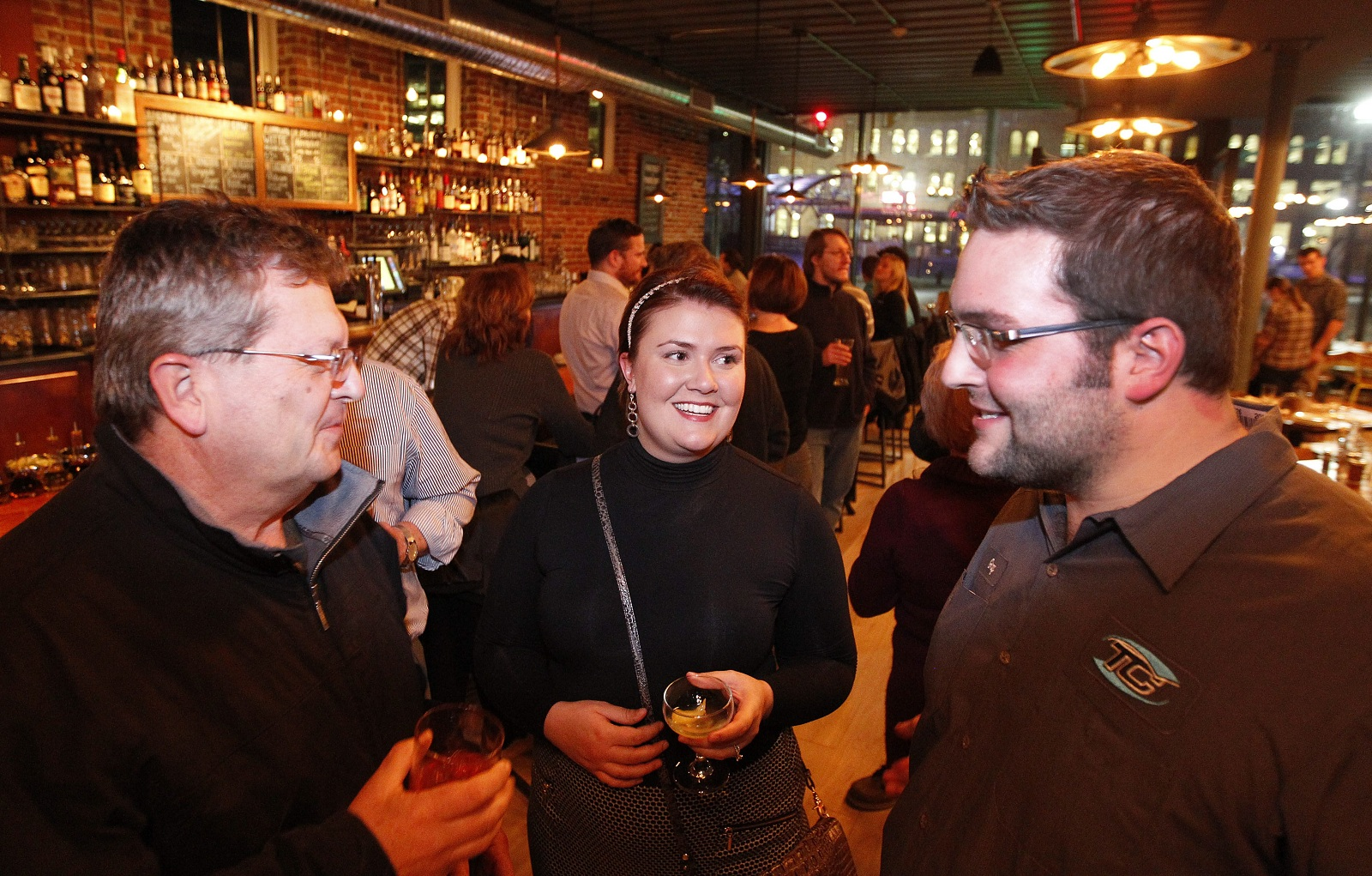 Hanging out in Hydraulic Hearth are, from left, Joe Pokorski of Depew and Lauren and Greg Davis of Lackawanna. (Sharon Cantillon/Buffalo News)