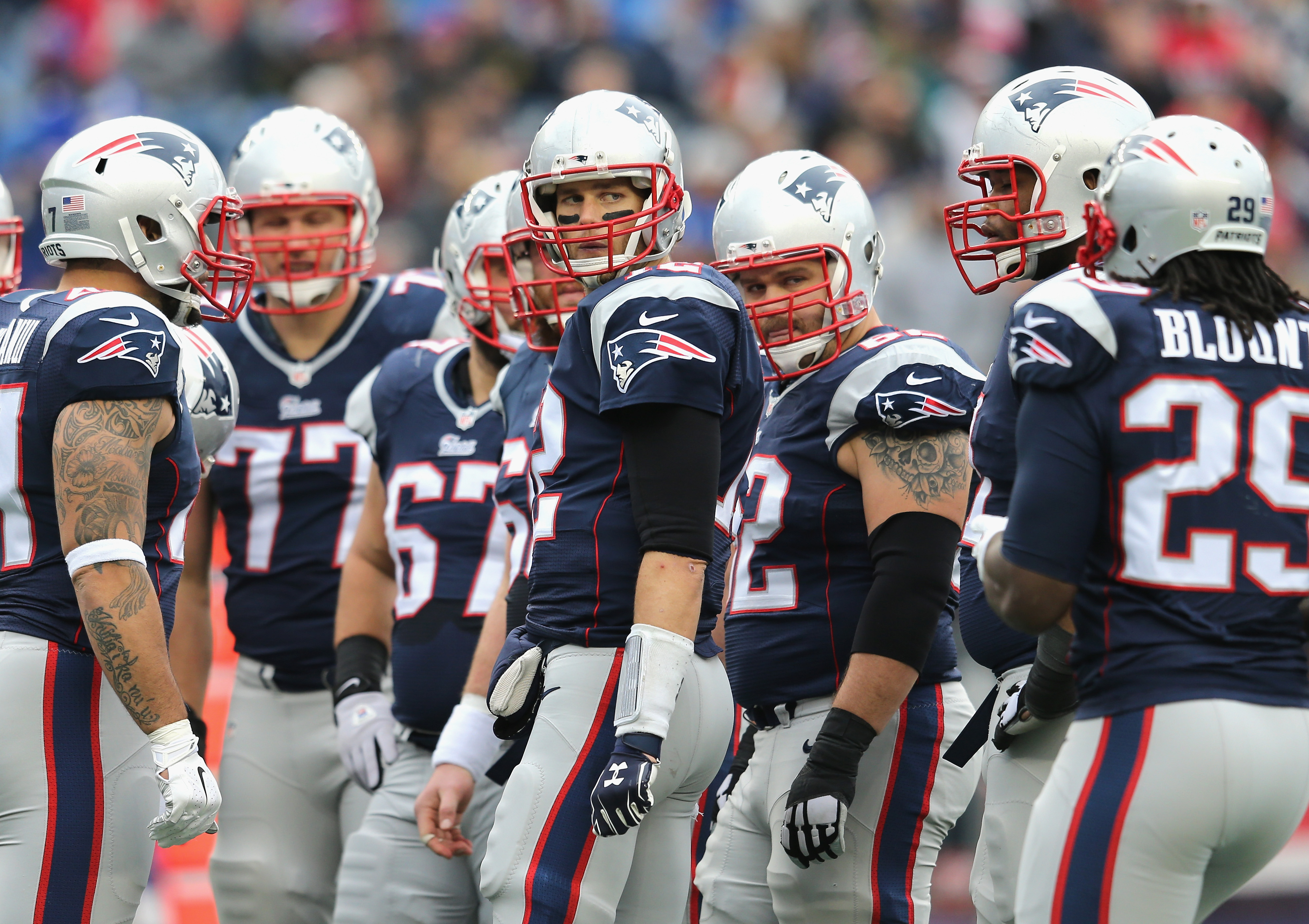 Tom Brady of the New England Patriots in a huddle against the Bills. (Getty Images)