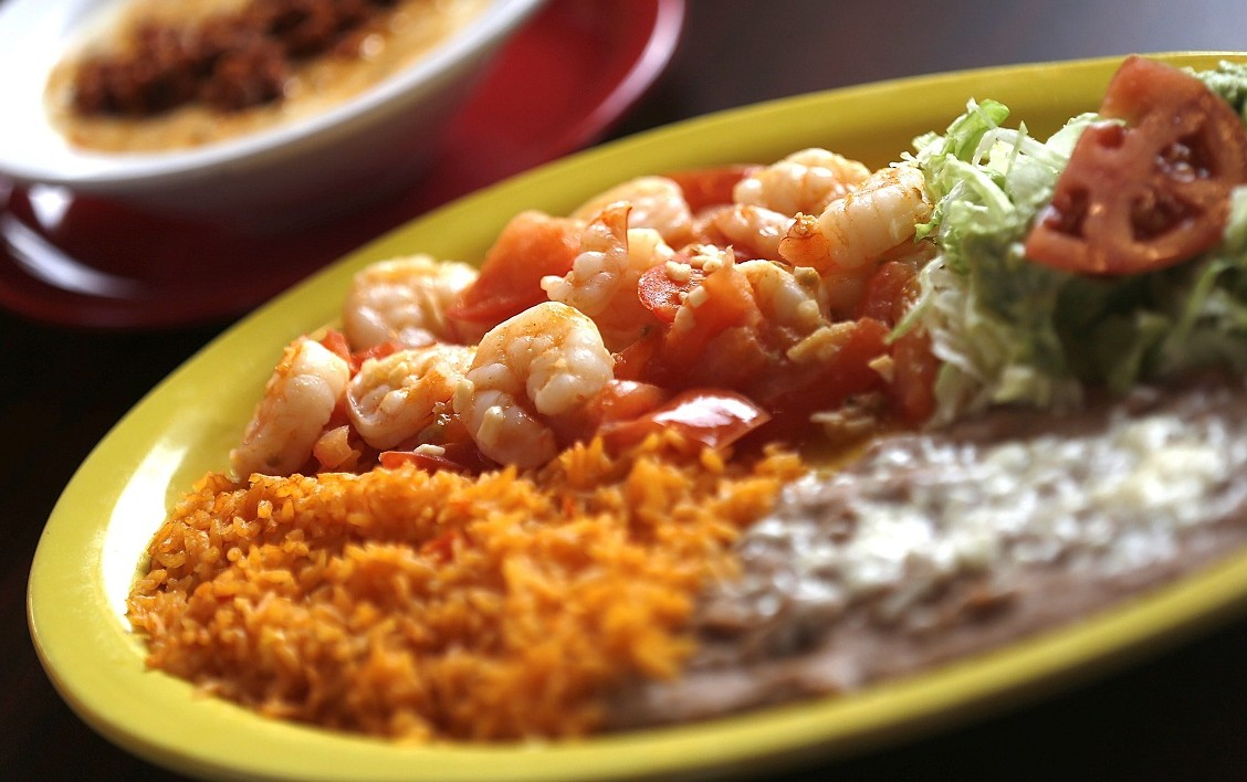 An abundant helping of shrimp sauteed with fresh tomatoes and chopped garlic at Aguacates' Lockport location. (Robert Kirkham/Buffalo News)