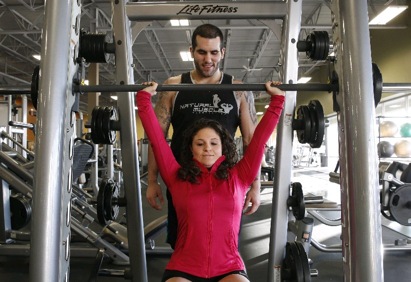 Bianca Roberts, 23, of Grand Island, and her boyfriend Dominic Fraterrigo, 23, of Kenmore, work out last weekend at Best Fitness on Elmwood Avenue. They support each other in their fitness and weight loss goals. (SharonCantillon/Buffalo News)