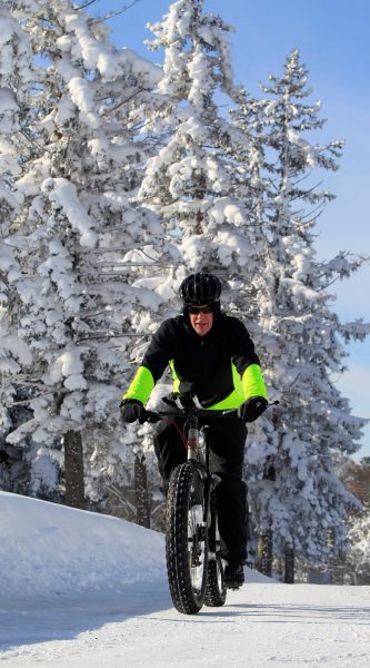 Bill Graves rides his bike at Chestnut Ridge Park in Orchard Park during a reprieve of the November 2014 lake-effect storm. (Harry Scull Jr./Buffalo News)