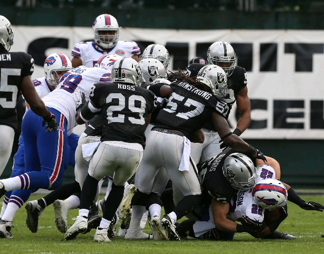 Fred Jackson is gang-tackled on a day when the Bills could not run the ball. (James P. McCoy/Buffalo News)