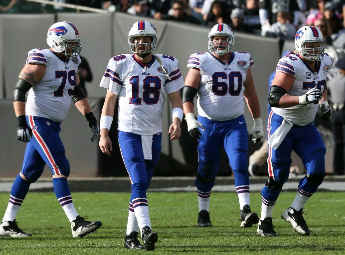Kyle Orton (18) and his offensive line during the second quarter of the Bills' playoff-hopes-ending loss in Oakland. (James P. McCoy/Buffalo News)