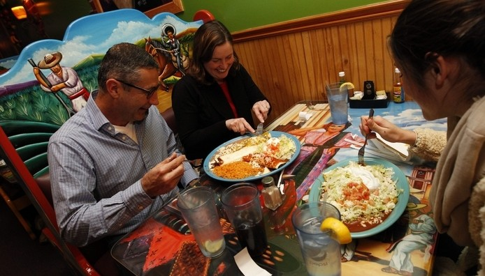 Jack and Julie Kuebler of Hamburg and their daughter Kit frequent El Canelo Mexican Restaurant a couple of times a month. See more photos at www.BuffaloNews.com (Sharon Cantillon/Buffalo News)