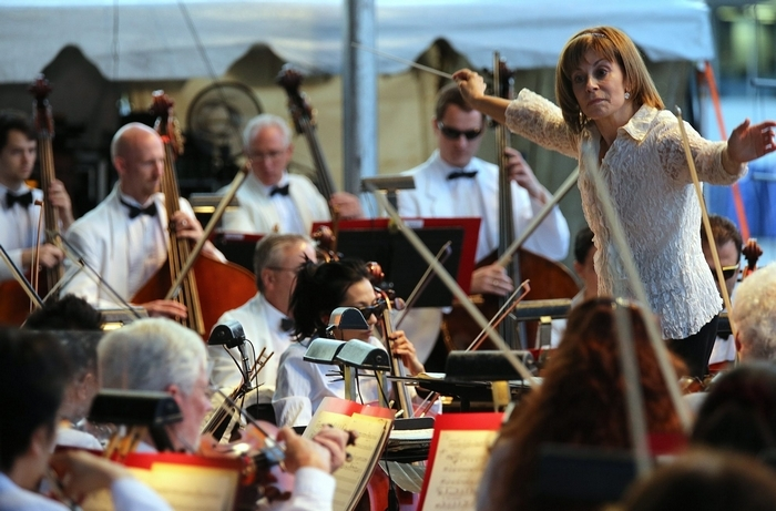 Maestra JoAnn Falletta conducts the Buffalo Philharmonic Orchestra during a performance on the opening night of the Erie County Fair in Hamburg on Aug. 6. (Charles Lewis/Buffalo News)