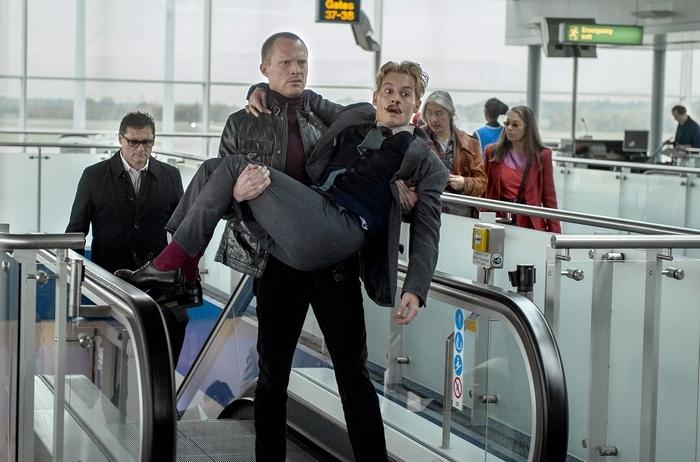 "Jock (Paul Bettany), left, and Charlie Mortdecai (Johnny Depp) in a scene from ""Mortdecai."" (David Appleby/Lionsgate)"