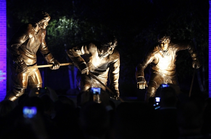 Fans snap pictures of the French Connection statue in Alumni Plaza at First Niagara Center in 2012. (Mark Mulville/Buffalo News file photo)