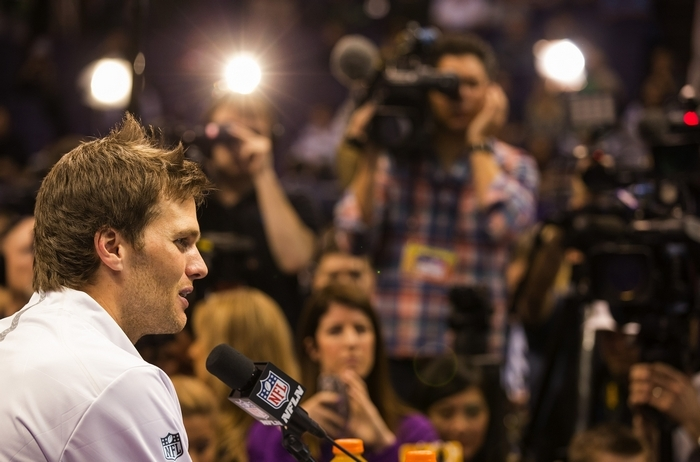 """Patriots quarterback Tom Brady talks to reporters during Super Bowl XLIX Media Day on Tuesday, but had nothing to say about the """"Deflategate"""" controversy."""