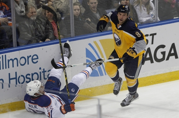 The Buffalo Sabres took on the Edmonton Oilers at the Firstt Niagara Center, Friday, Nov. 7, 2014. This is period two action. Sabres Cody McCormick takes down Keith Aulie. (Photo by Sharon Cantillon/Buffalo News)