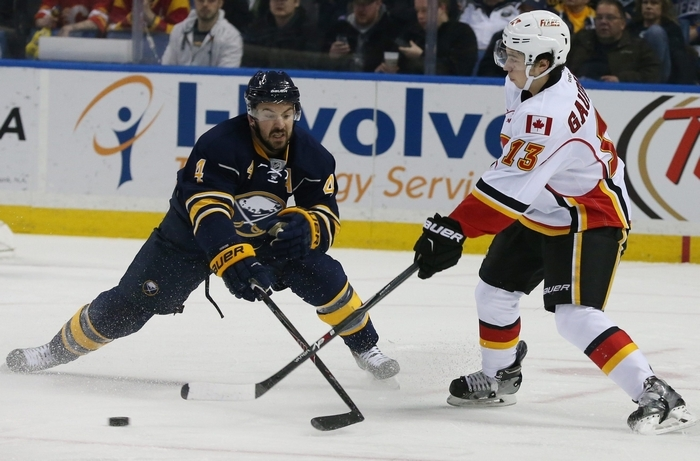 Sabres defenseman Josh Gorges, battling Calgary Flames left wing Johnny Gaudreau, has the lowest plus-minus figure in the NHL at -26. (James P. McCoy/Buffalo News)