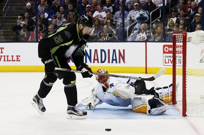 Buffalo Sabres center Zemgus Girgensons fails to get a shot off against goalie Roberto Luongo of the Florida Panthers during the first period. (Getty Images)