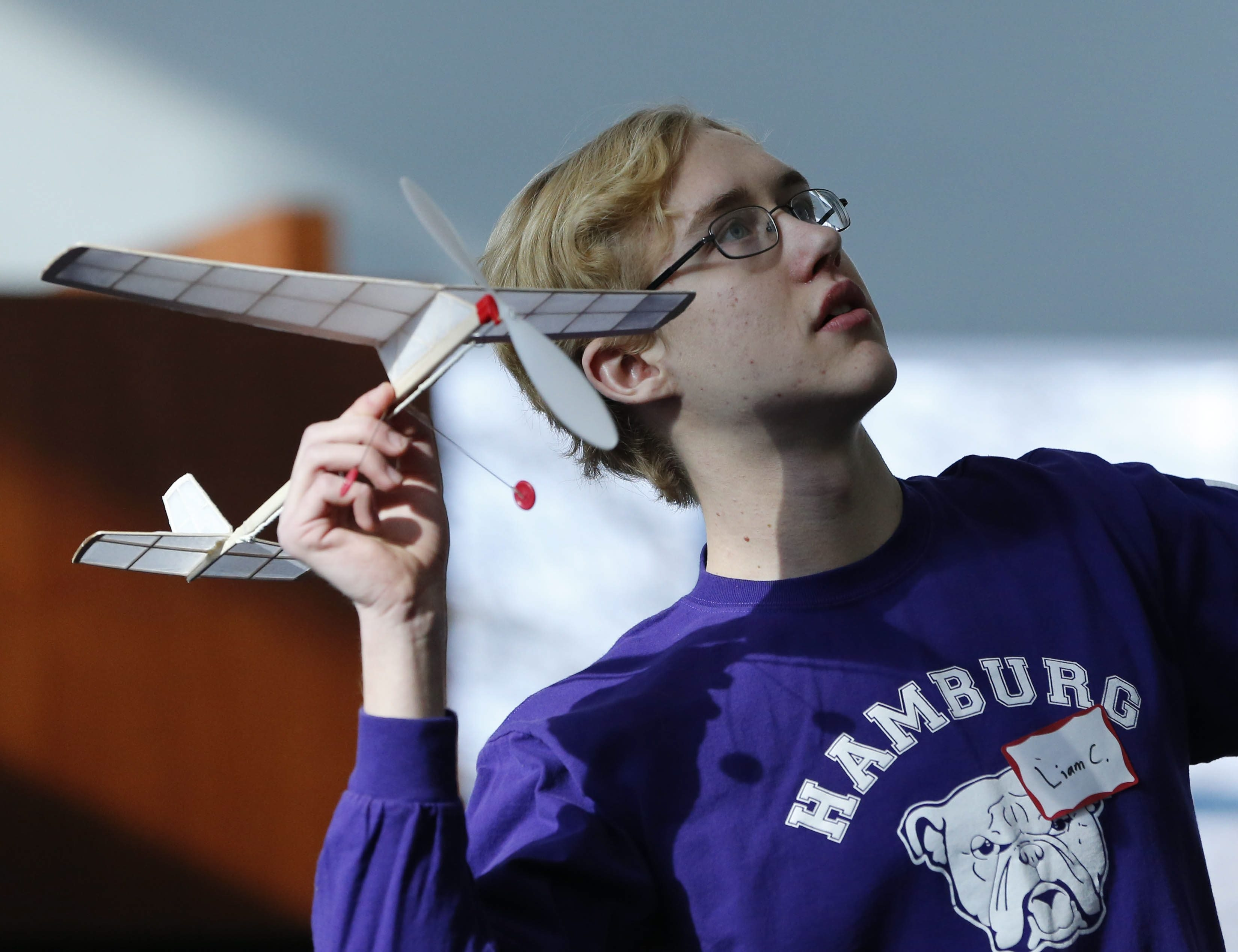 Liam Callahan, 16, of Hamburg, launches his team's entry in the model plane event during the Science Olympiad at Canisius College on Saturday. More than 600 area high school students competed in the Olympiad's 25 science-related events.