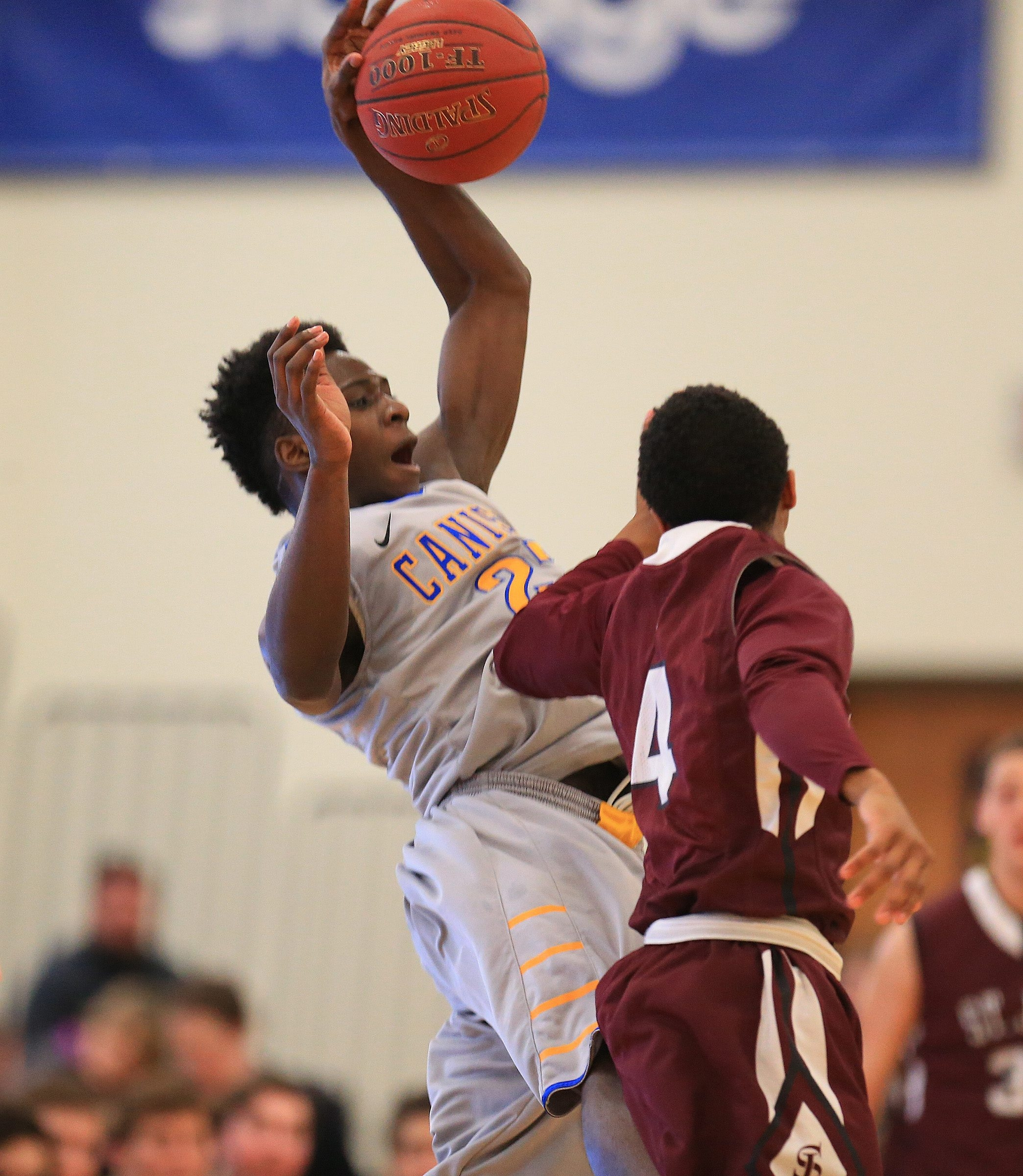 LaTerrance Reed of Canisius tries to control the ball against Naseer Jackson of St. Joe's. Reed had 24 points in the Crusaders' 71-60 win.
