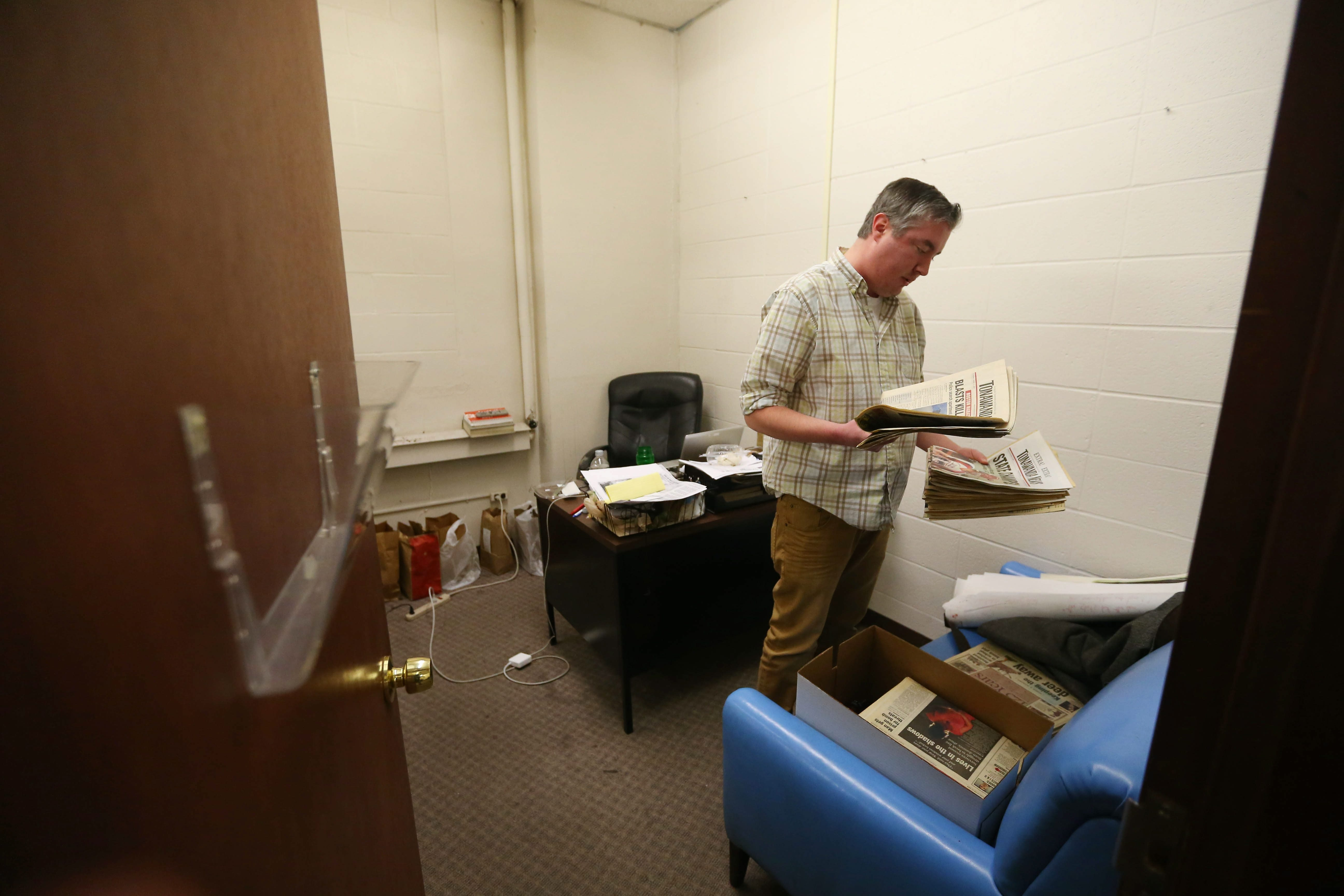 Eric DuVall, managing editor of the Tonawanda News, cleans out his office in the newsroom in North Tonawanda on Thursday.  The newspaper published its last edition Saturday.