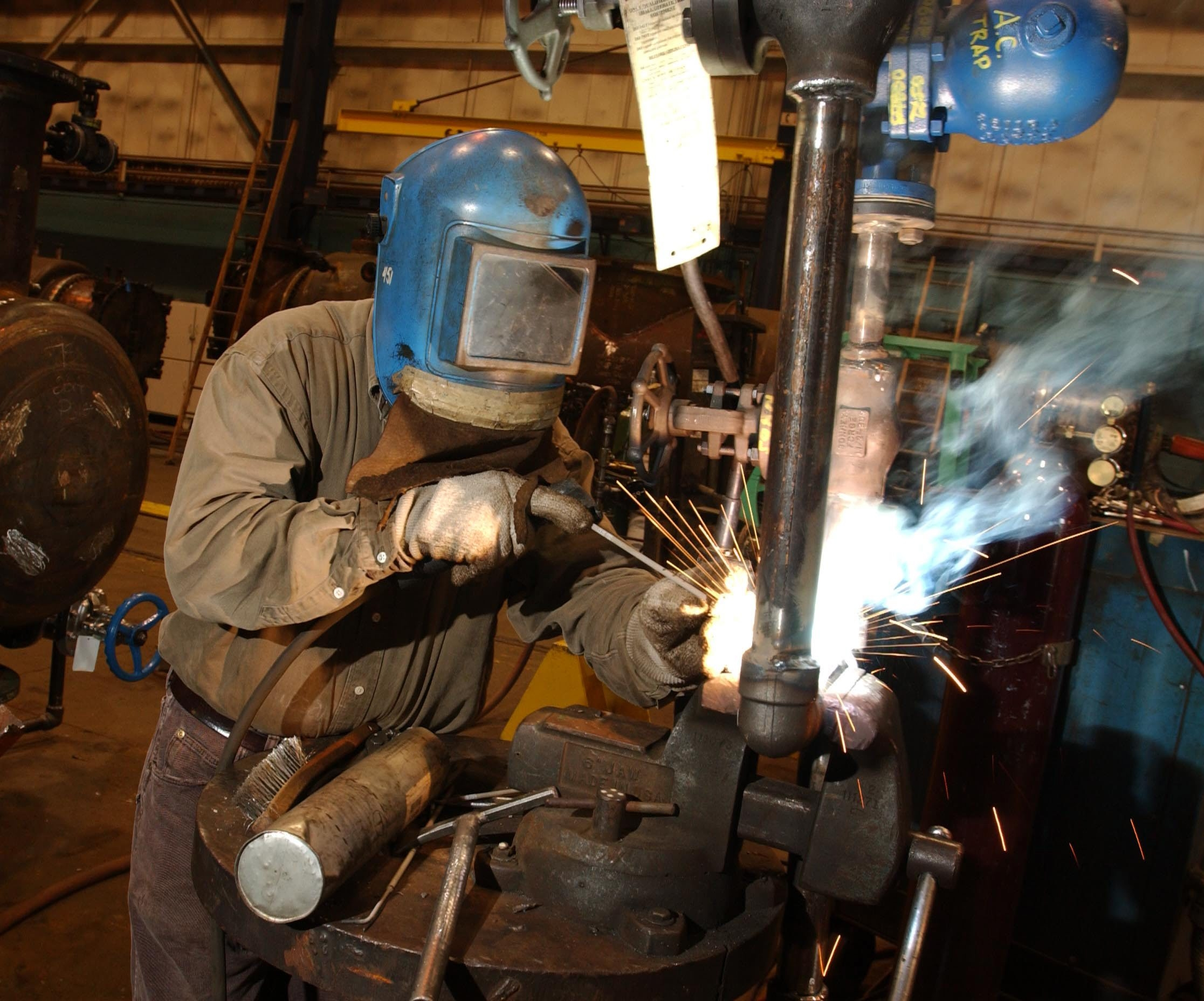 A welder at Graham Corporation in Batavia prepares equipment for the oil industry.