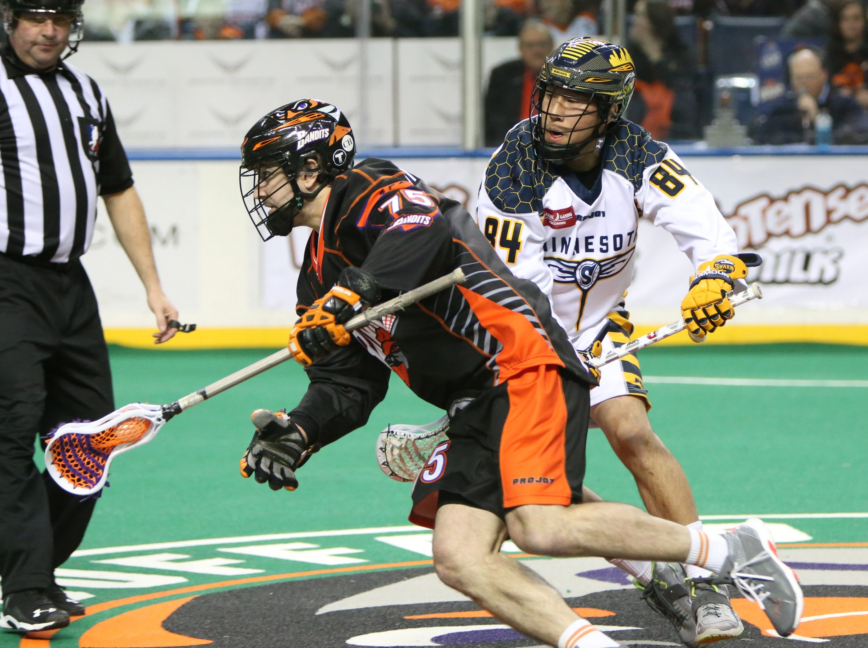 Jay Thorimbert of the Bandits powers past Minnesota's Corbyn Tao in the second quarter at First Niagara Center.