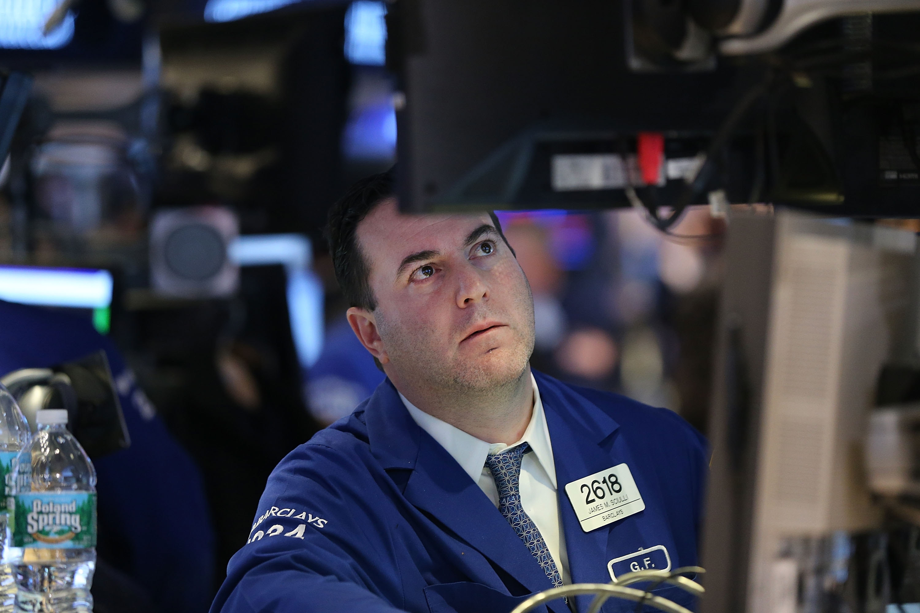 Traders work on the floor of the New York Stock Exchange in New York City. Stocks fell again on Wednesday as news of oil's continuing slide and concerns about the global economy rattled markets.