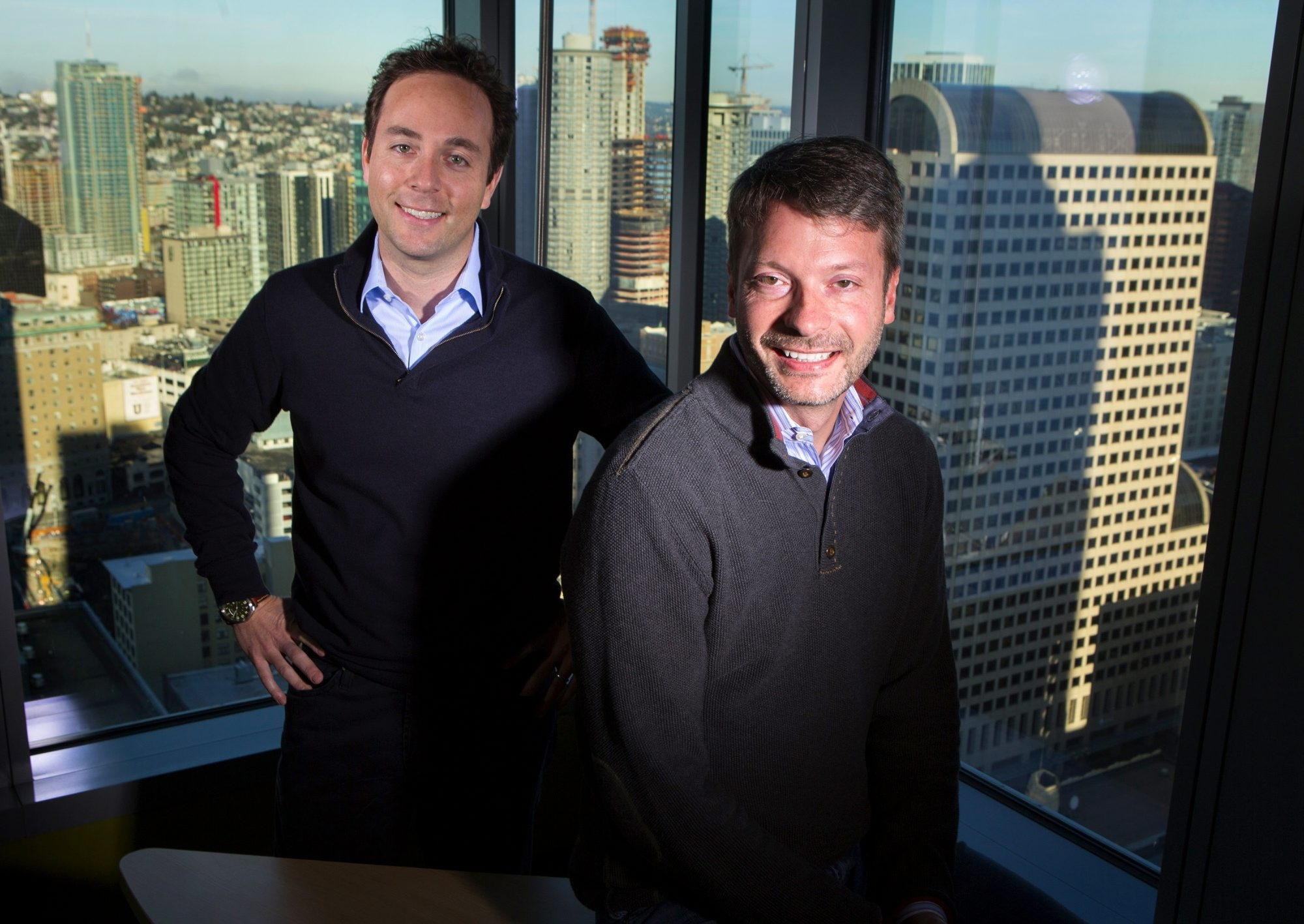 "Zillow CEO Spencer Rascoff, left, and chief economist Stan Humphries, in their downtown Seattle office, co-wrote a forthcoming book, ""Zillow Talk: The New Rules of Real Estate."" In it they ""tried to capture ... the spirit of real estate,"" Rascoff said. (Ellen M. Banner/Seattle Times/TNS)"