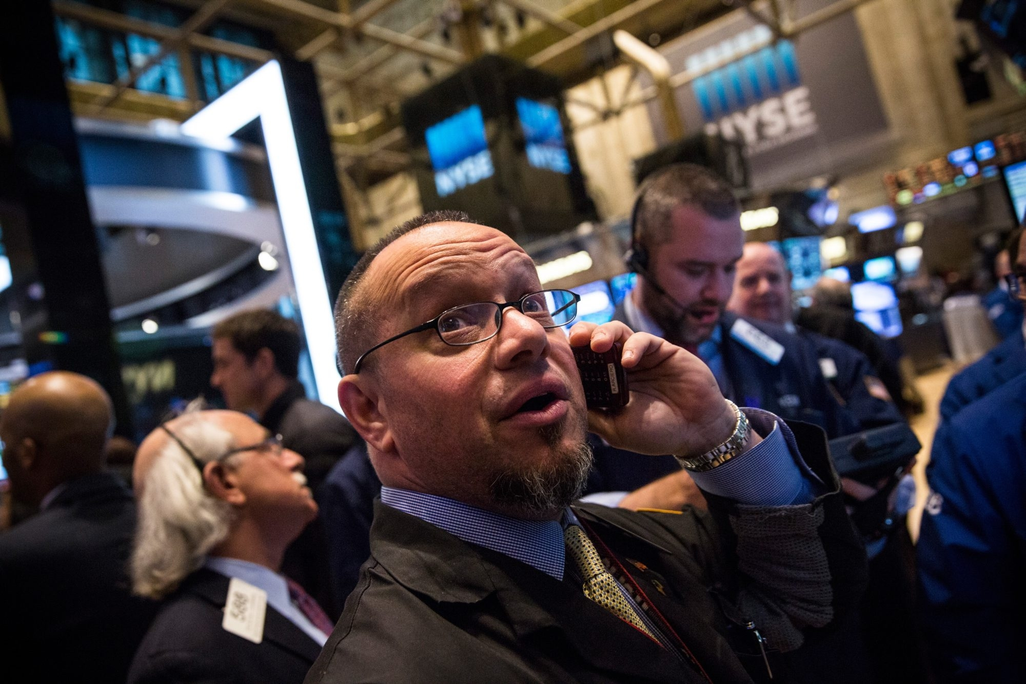 New York Stock Exchange traders found few encouraging figures Tuesday as the Dow Jones industrial average fell by 291.49 points, to 17,387.21, after losing almost 400 early in the day. The Nasdaq 100's 2.6 percent drop was its worst since April, and the Standard & Poor's 500 slipped to 2,029.55, below its previous 50-day average.