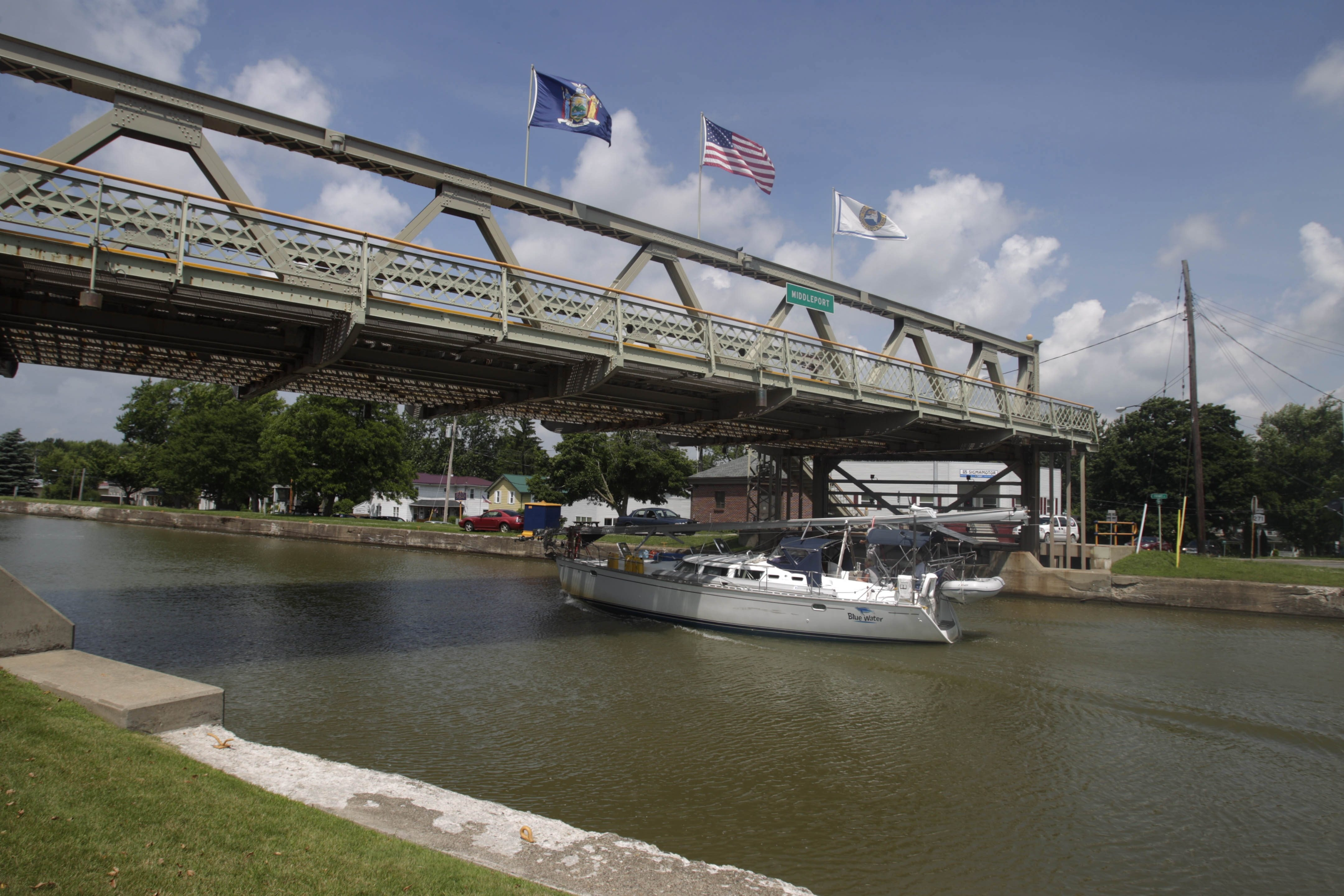 A sailboat passes under the lift bridge in Middleport as it travels on the Erie Canal. The bridge, which is being painted, will be open to participants in Mr. Ed's Race today, race organizers said.