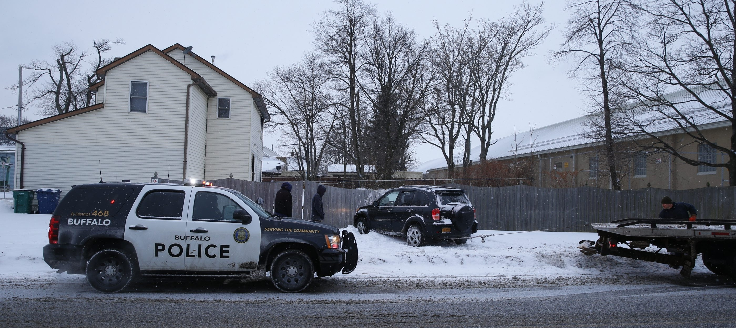 A car went off the road on Best Street and hit a fence on slick roads this morning on Tuesday, Jan. 27, 2015.    (John Hickey/Buffalo News)
