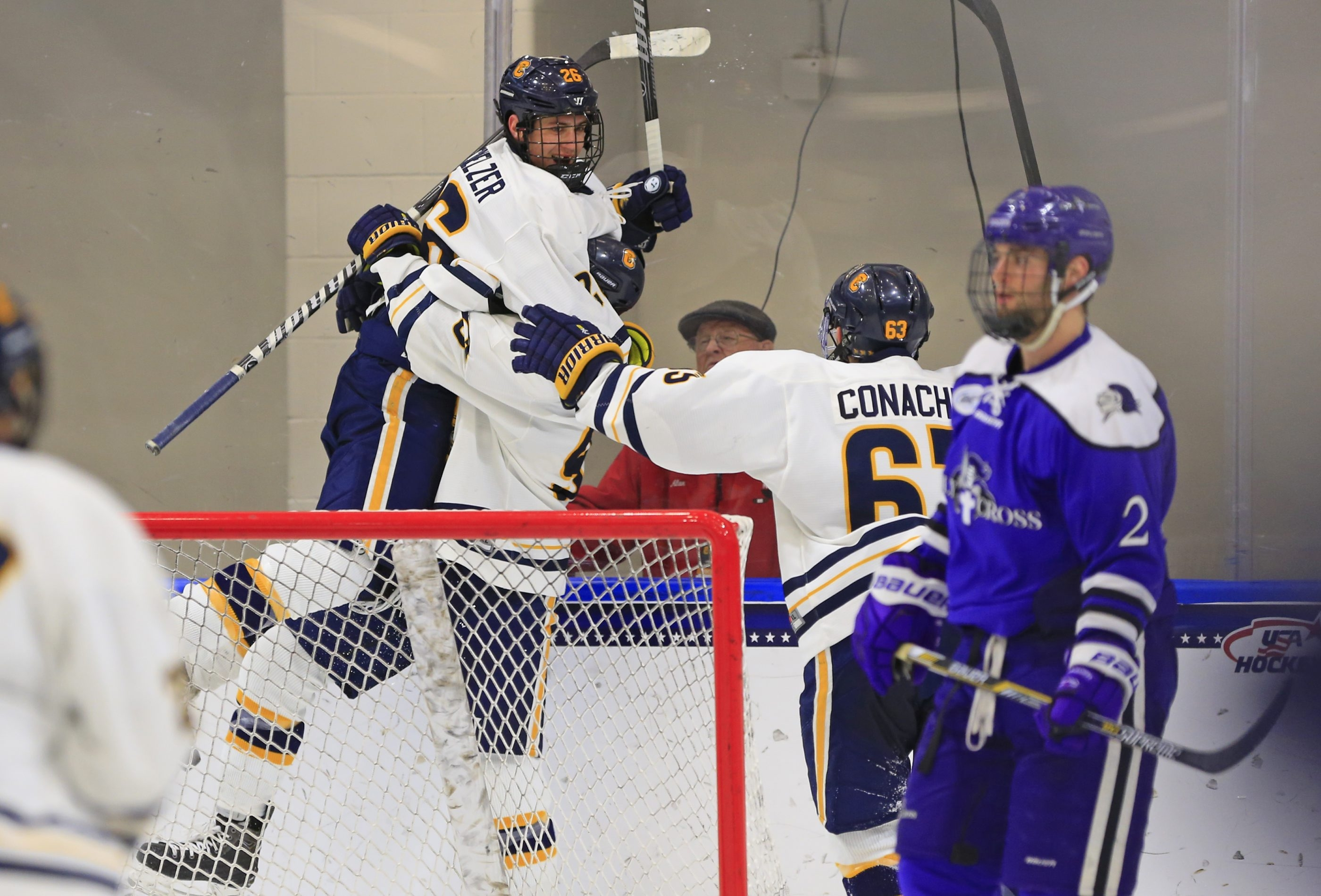 Canisius College's Ryan Schmelzer (26) celebrates his game winning goal in overtine against  Holy Cross during action in the Atlantic Hockey conference at the HarborCenter in Buffalo,NY on Friday, Jan. 9, 2015. USA defeated Russia 7-1 (Harry Scull Jr./Buffalo News)