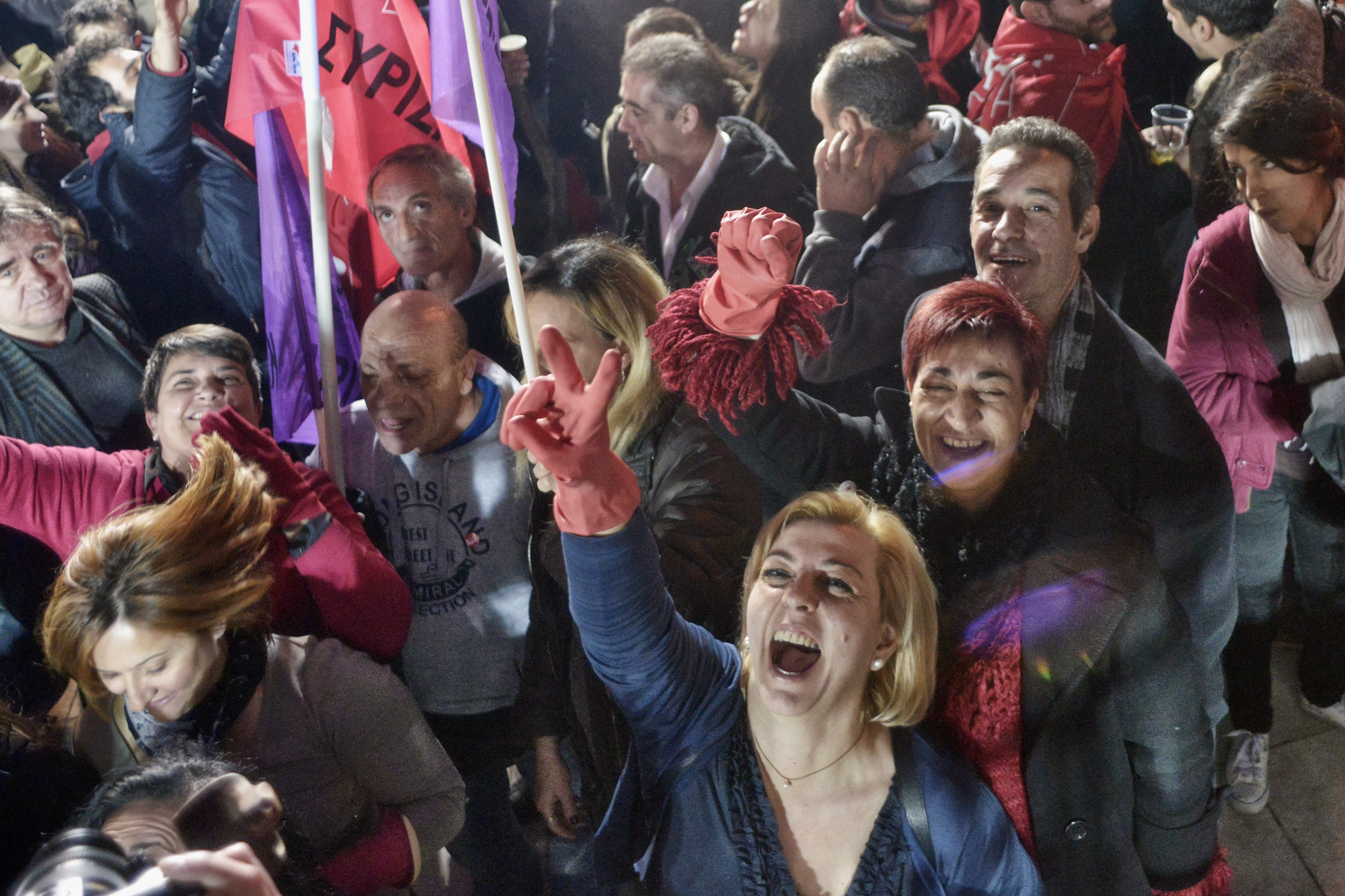 Supporters of Alexis Tsipras, leader of Syriza left-wing party, cheer during a rally outside Athens University Headquarters on Sunday in Greece.