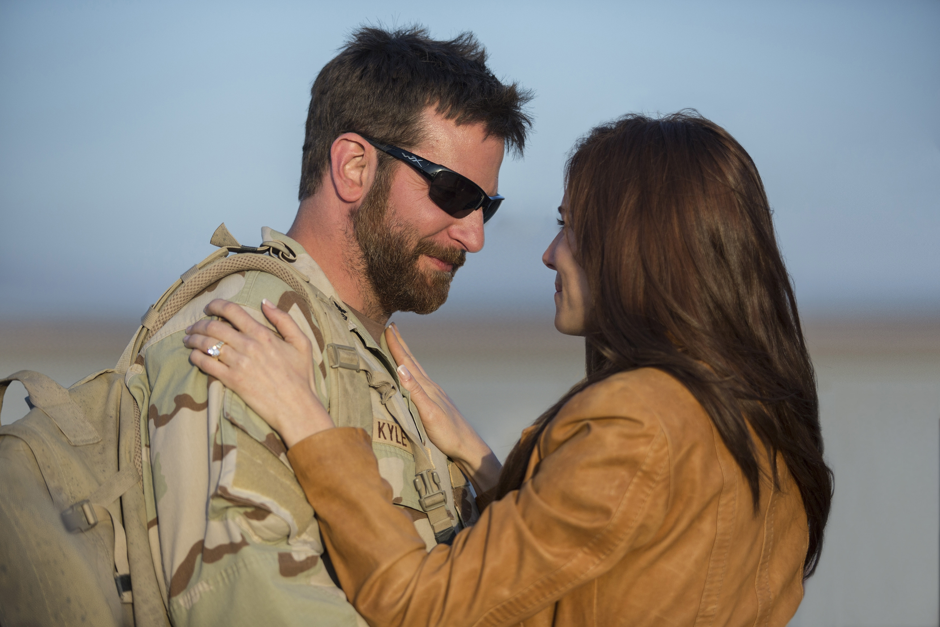 """Bradley Cooper stars as Chris Kyle and Sienna Miller as Taya Kyle in Warner Bros. Pictures' and Village Roadshow Pictures' drama """"American Sniper."""""""