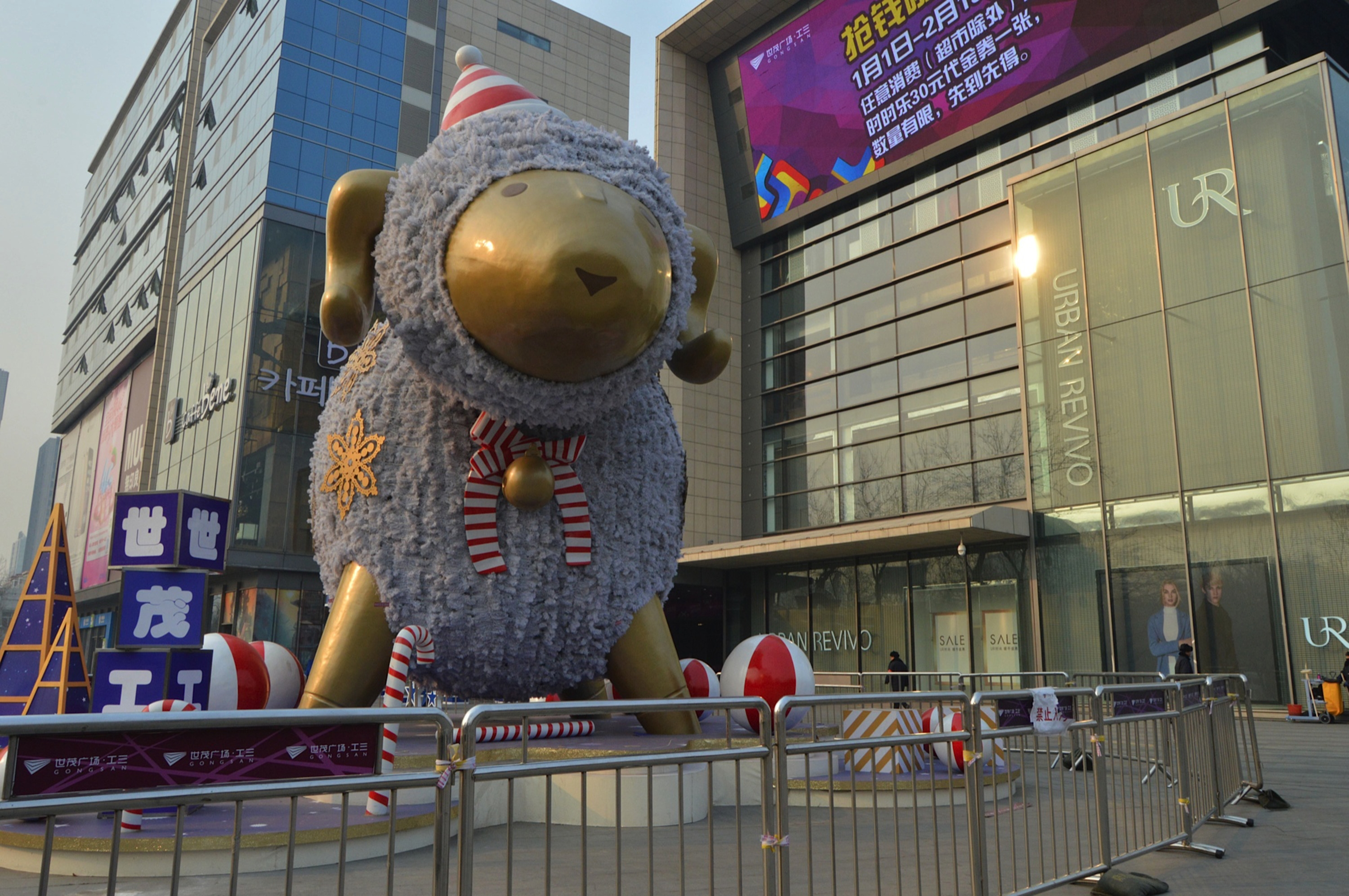 A giant sheep statue stands outside a shopping center in Beijing. China will usher in the year of the sheep on Feb. 19, and many people believe it's unlucky for a person to be born in the year of the sheep.