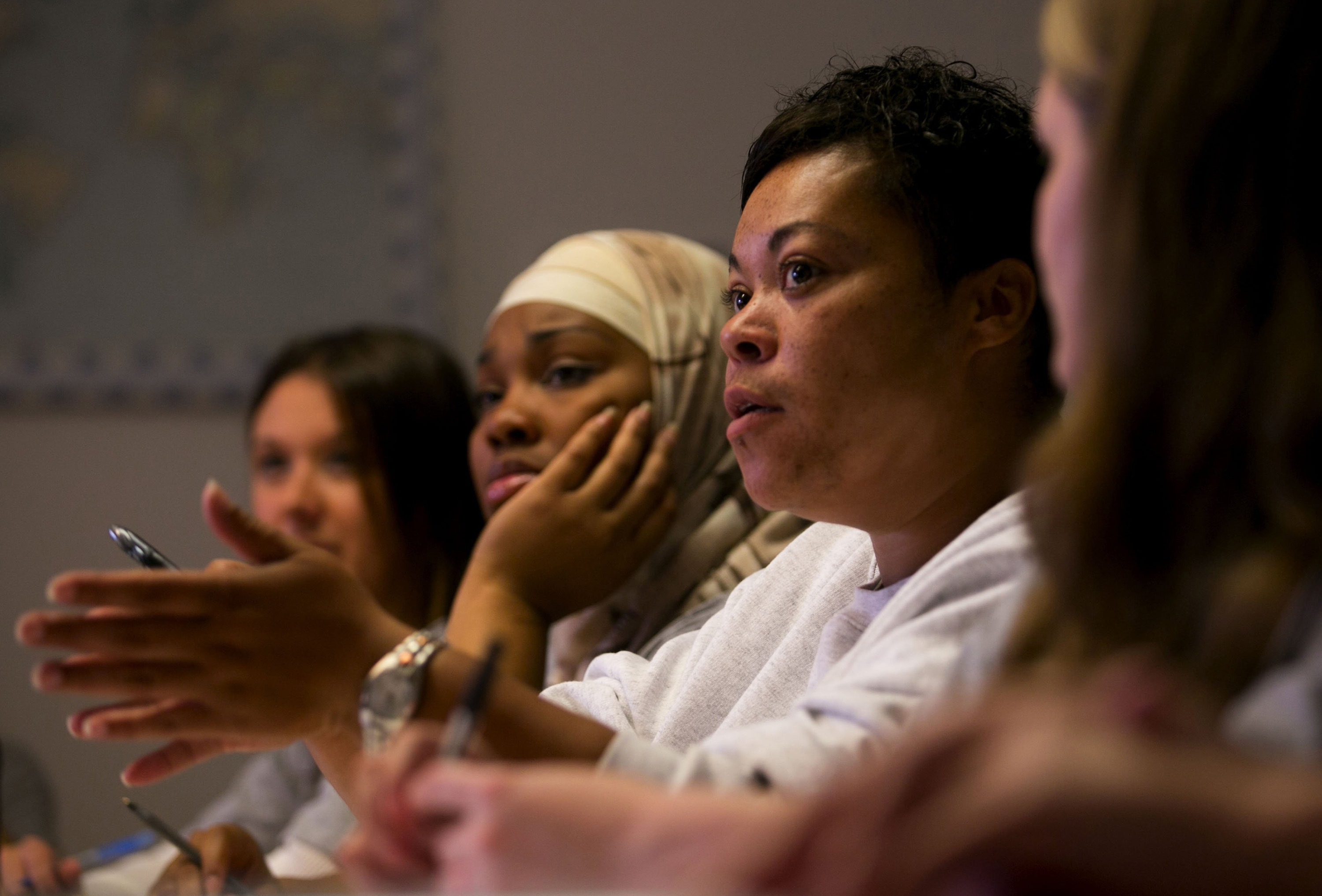Lisa Kanamu, second from right, joins a discussion during a government class at the Washington Corrections Center for Women. A 2013 study found that prisoners enrolled in education programs were 43 percent less likely to return to prison within three years of release.