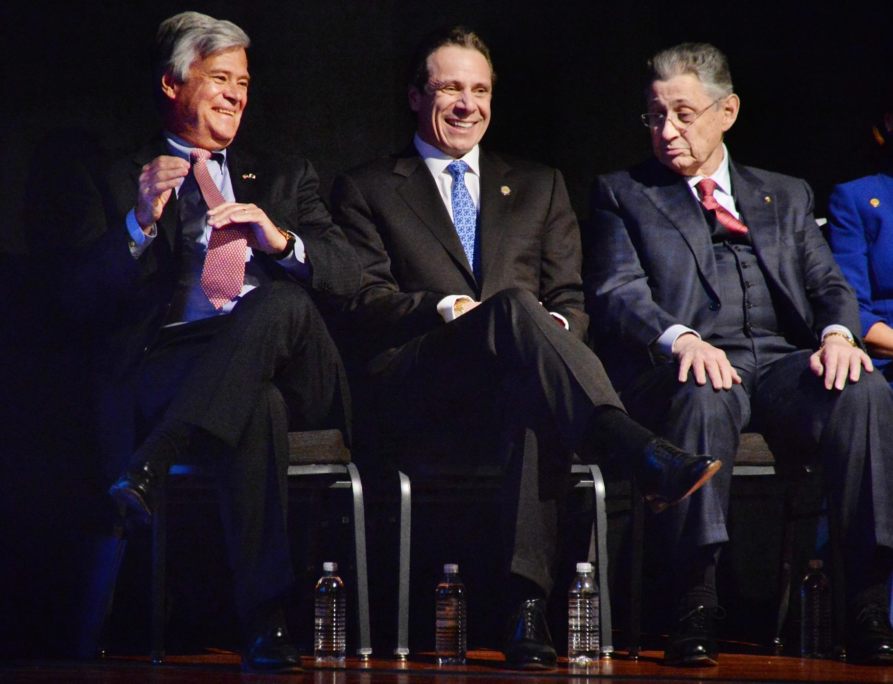 Senate Majority Leader Dean Skelos, left, Gov. Andrew M. Cuomo and Assembly Speaker Sheldon Silver share a light moment during the State of the State address Wednesday, one day before Silver was arrested.