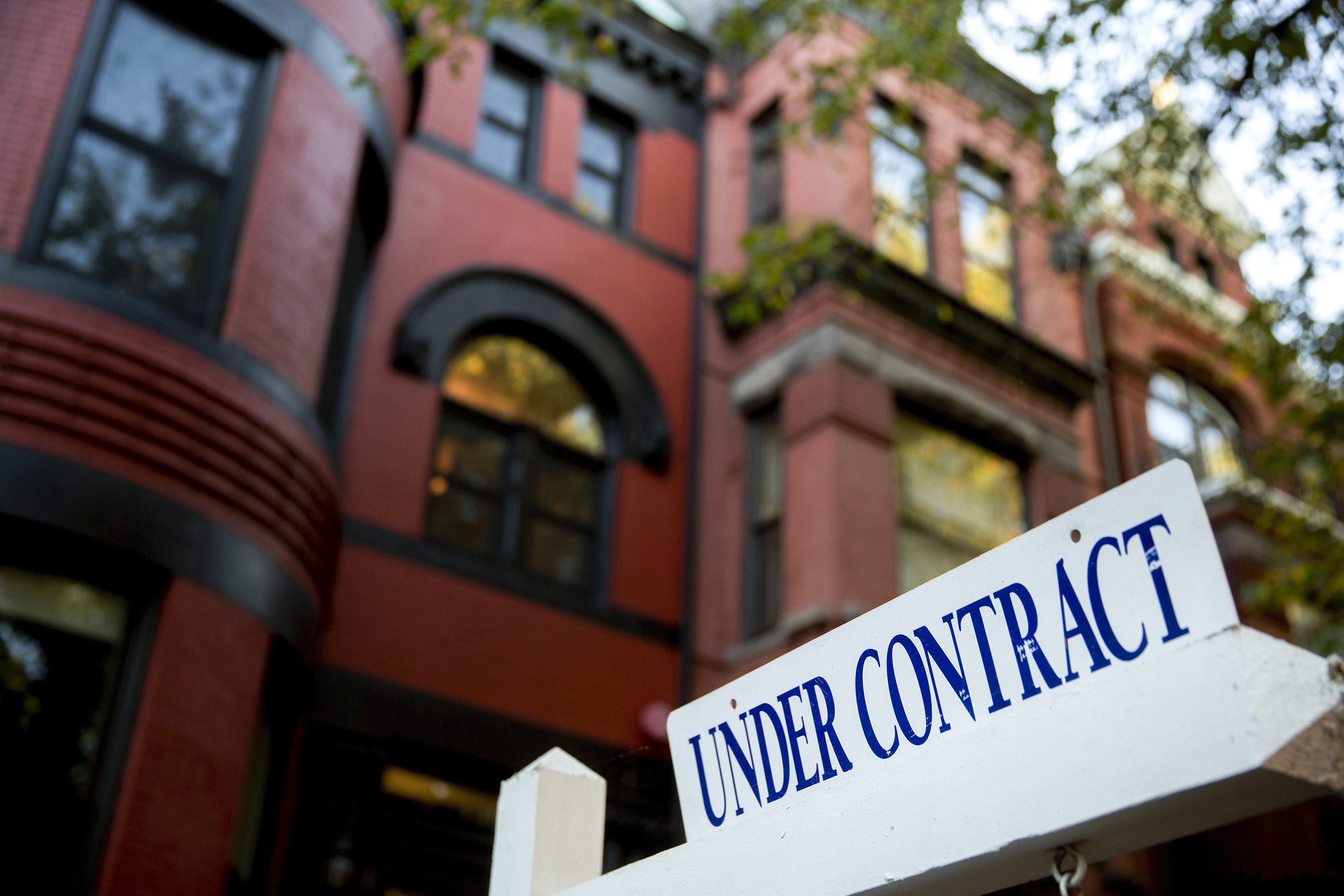"""An """"Under Contract"""" sign stands outside a property in Washington, D.C., U.S., on Friday, Oct. 17, 2014. The National Association of Realtors is scheduled to release existing home sales figures on Oct. 21. Photographer: Andrew Harrer/Bloomberg"""