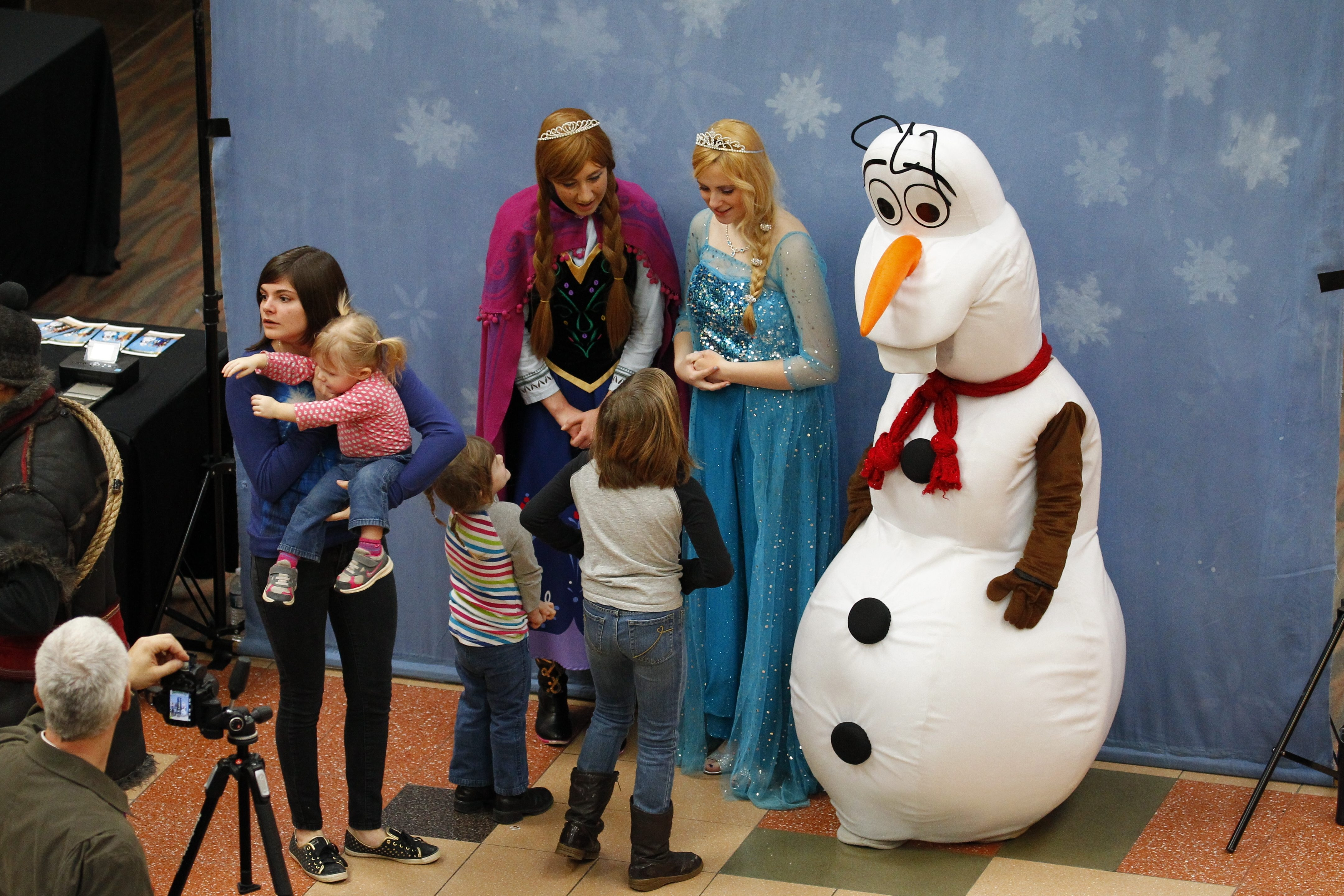 """Top, children greet characters from Disney's hit movie """"Frozen"""" at the Walden Galleria on Sunday. Left, Shane Liszewski and his children Kierra, 6, right, and Kaylynn, 3, left, wait patiently in line with other parents and children at the mall event. Above, Samantha Cruz, of Hamburg, and her niece Ella White, 3, show their excitement."""