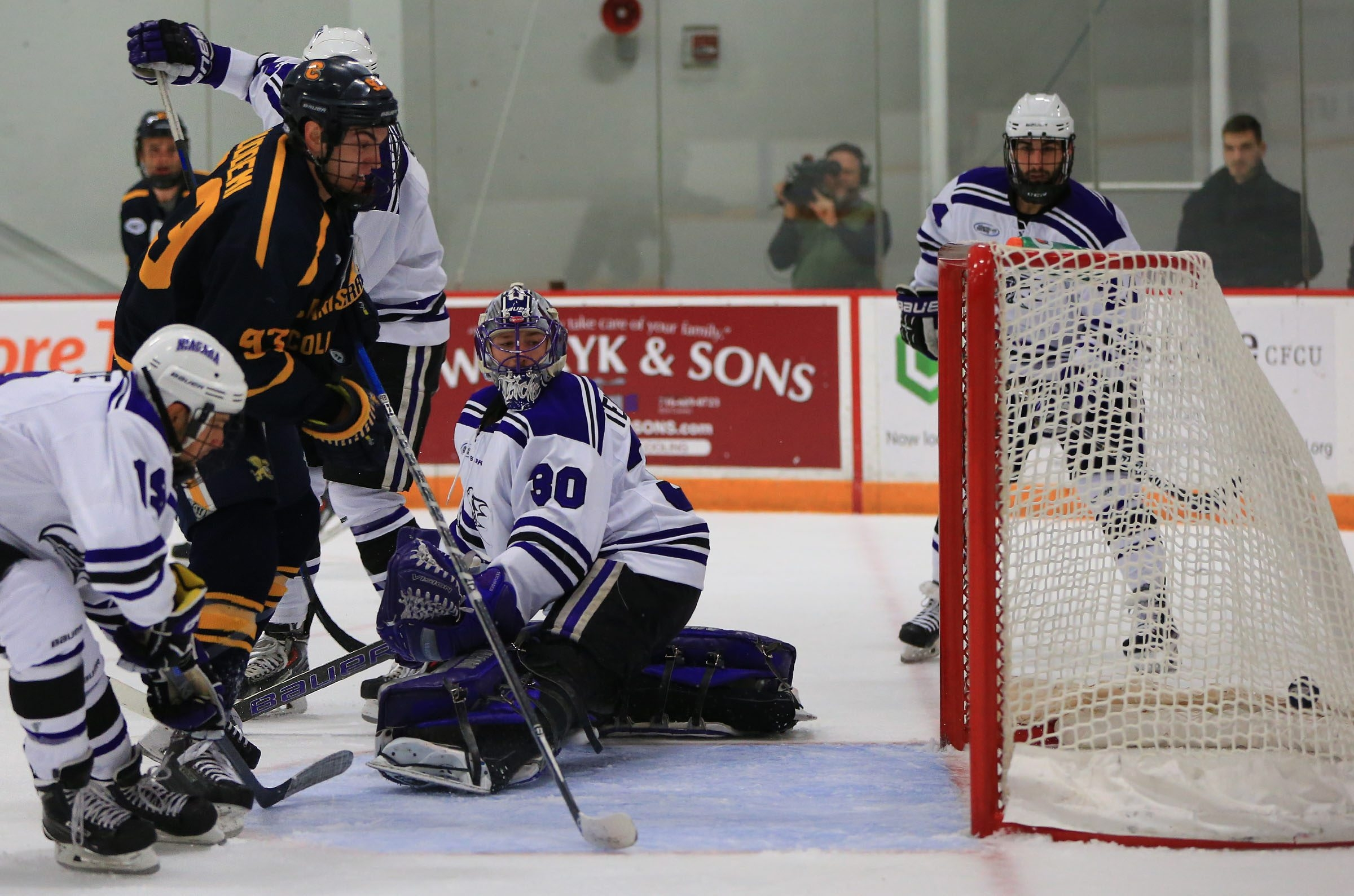 Ralph Cuddemi (93) of Canisius scores against Niagara goaltender Jackson Teichroeb during first-period action at Dwyer Arena.