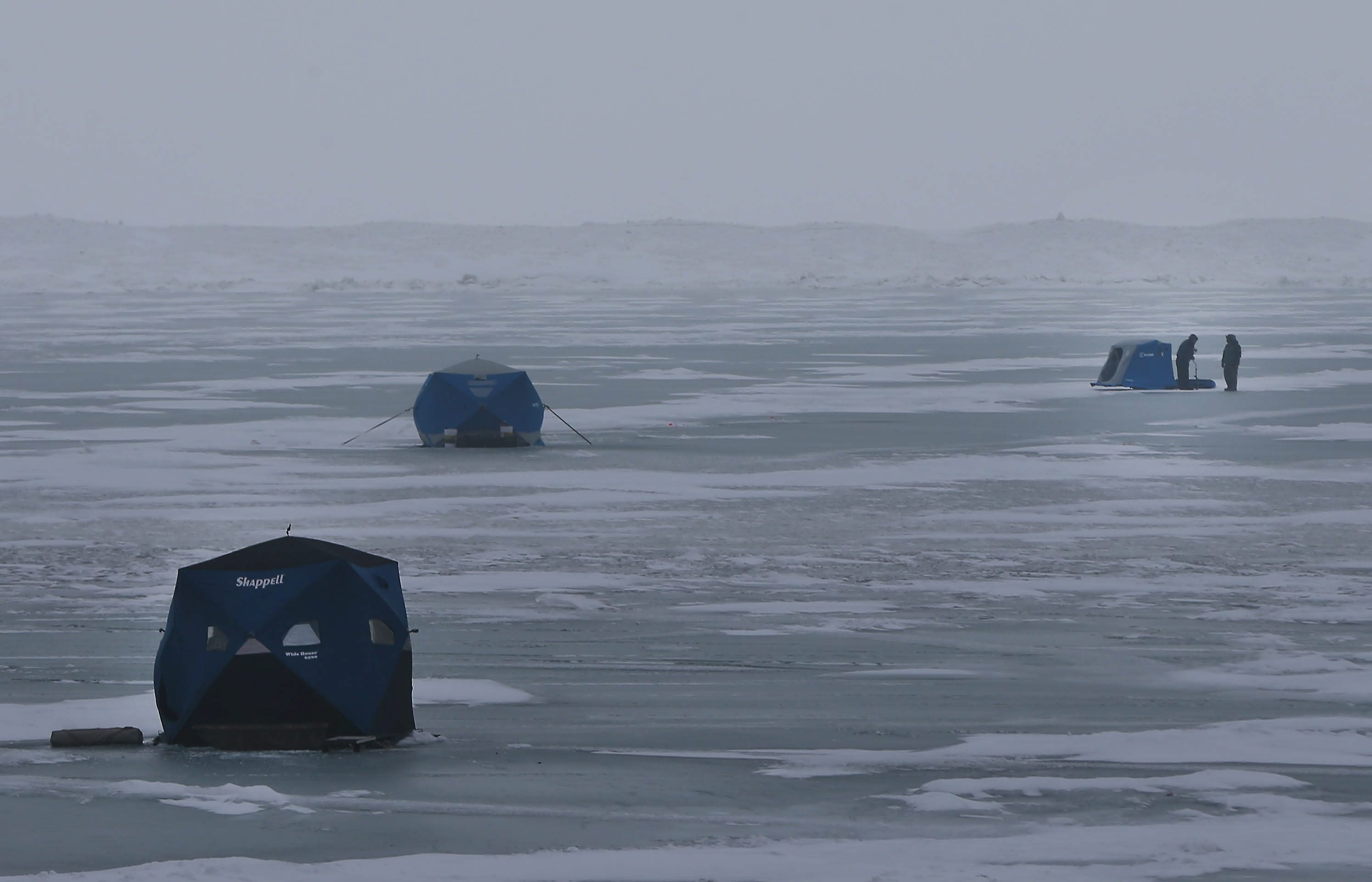 Ice fishermen brave the winds in the Small Boat Harbor in Buffalo on Saturday, when temperatures hovered in the upper 20s.
