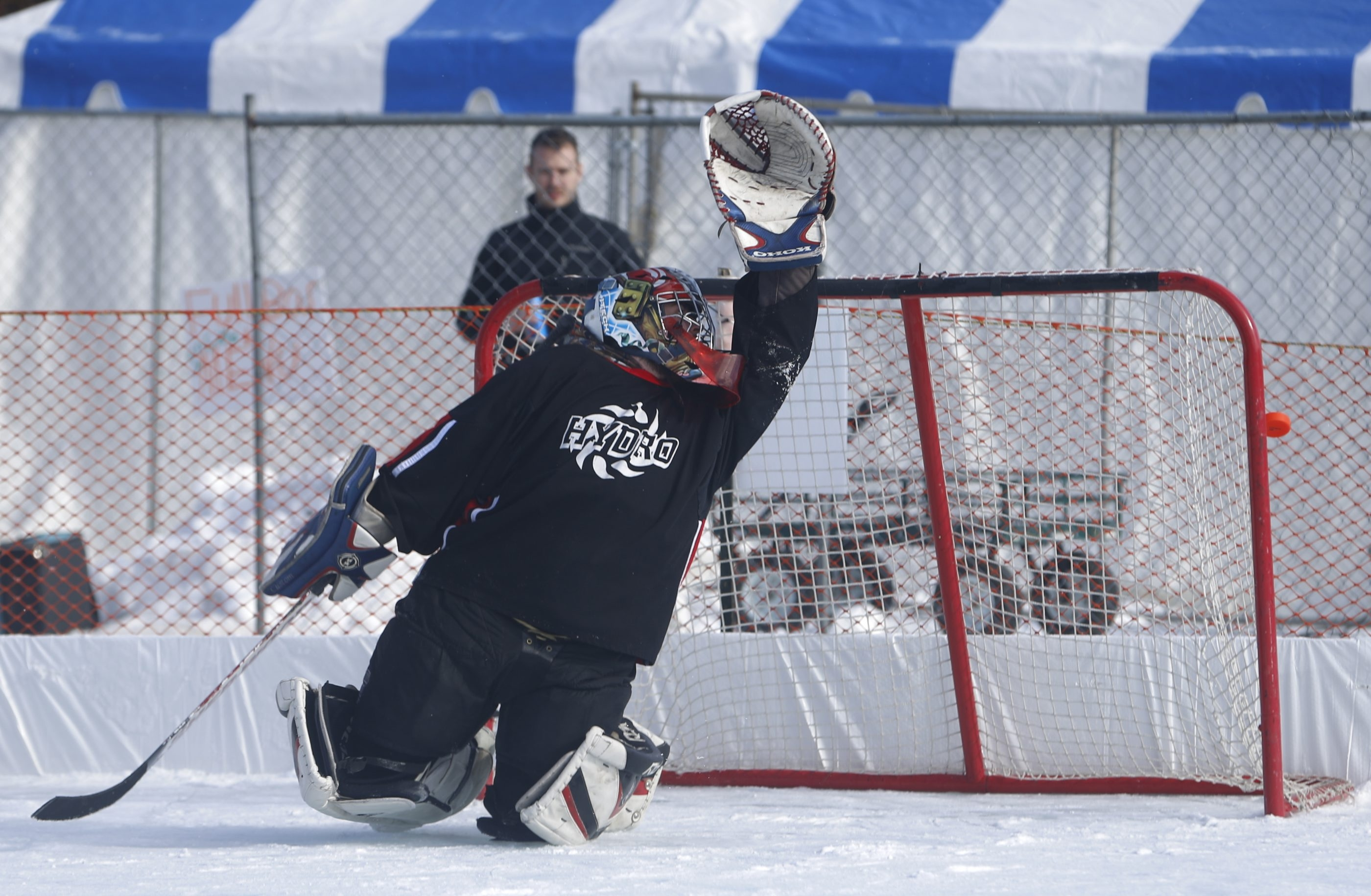 Hydro goalie Zack Patti defends against a shot by an Elbows of Fury player that hit the post in the Tim Hortons Backyard Classic pond hockey tournament. See a photo gallery at BuffaloNews.com.