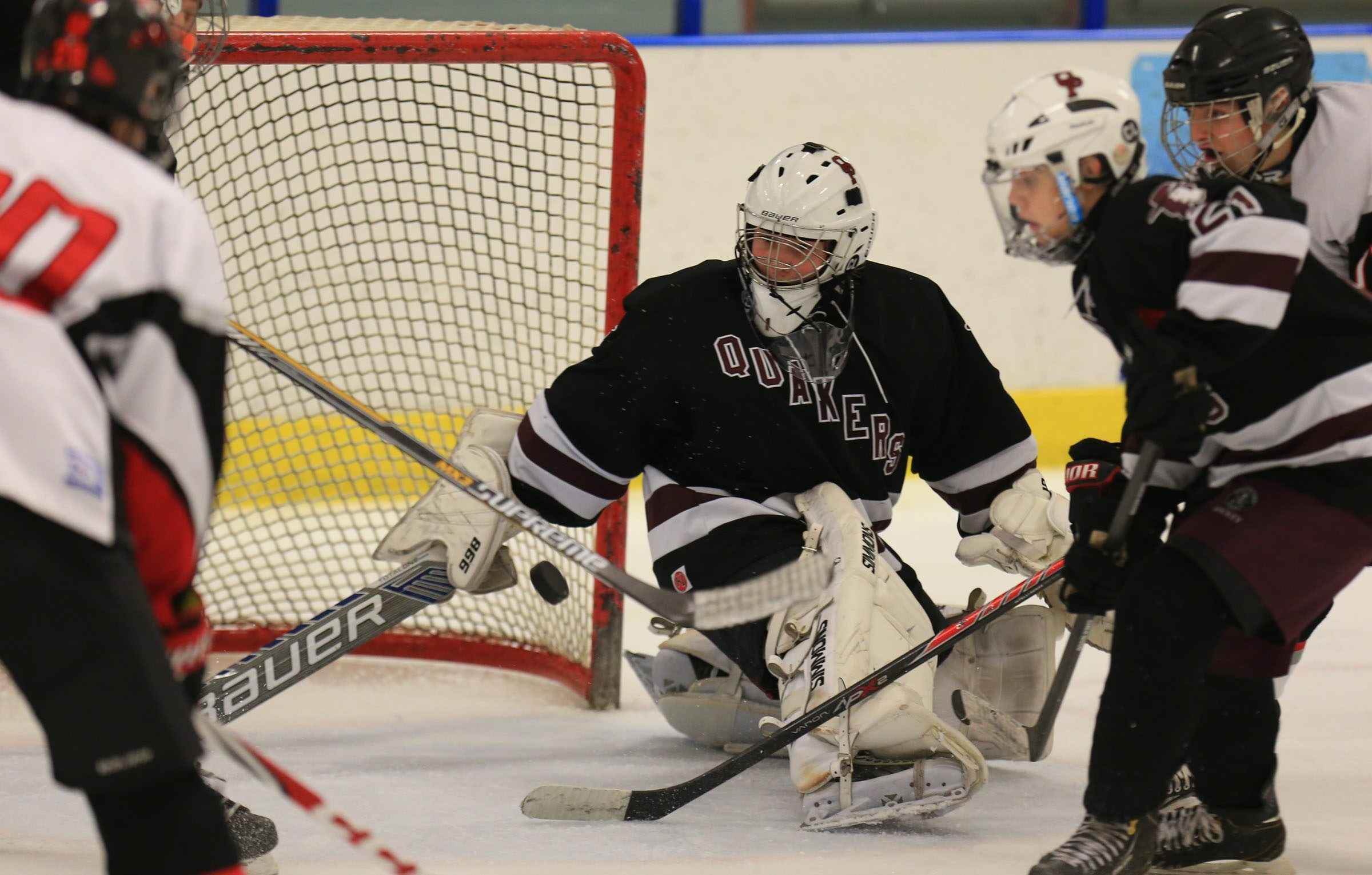 Orchard Park goaltender Tom Held makes a third-period save against Clarence at Northtown Center during the OP win.