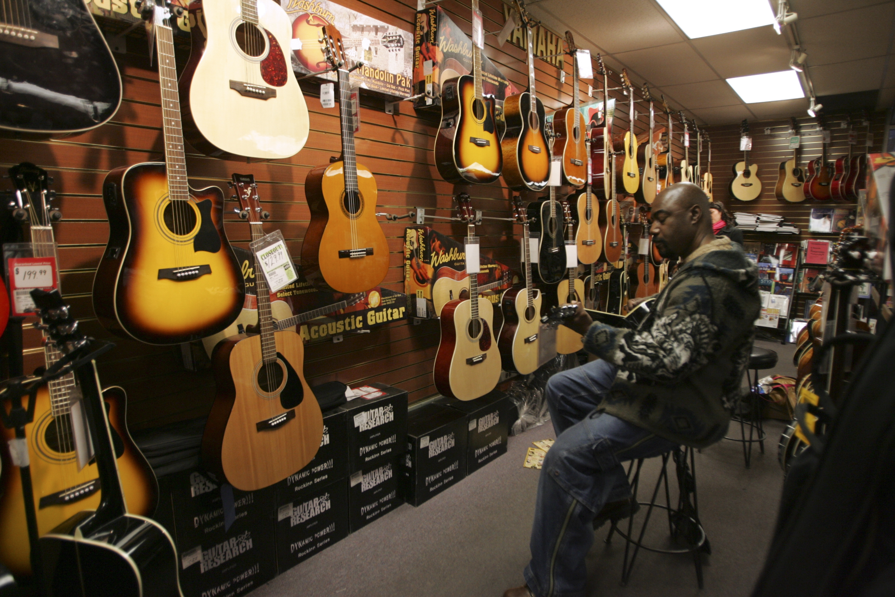 Nate Masuicca plays a guitar at a Sam Ash store in New York. The AARP's Life Reimagined division said that retirees are embracing passions of their youth, such as music, as they get older and have turned to those activities to fulfill their lives.