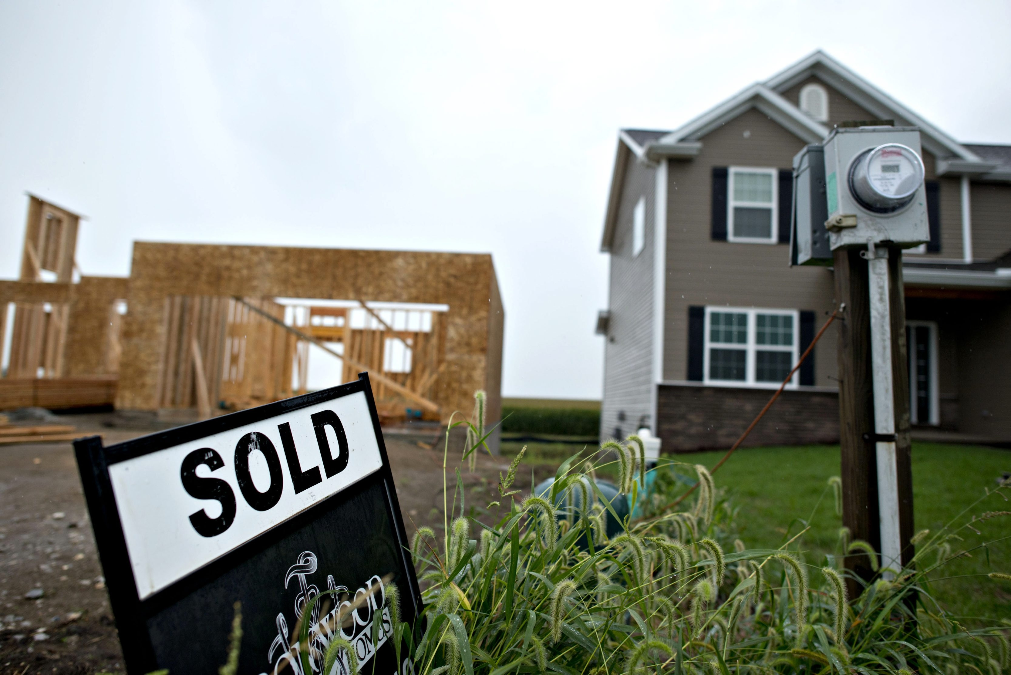A sold sign stands outside a home under construction. (Bloomberg)