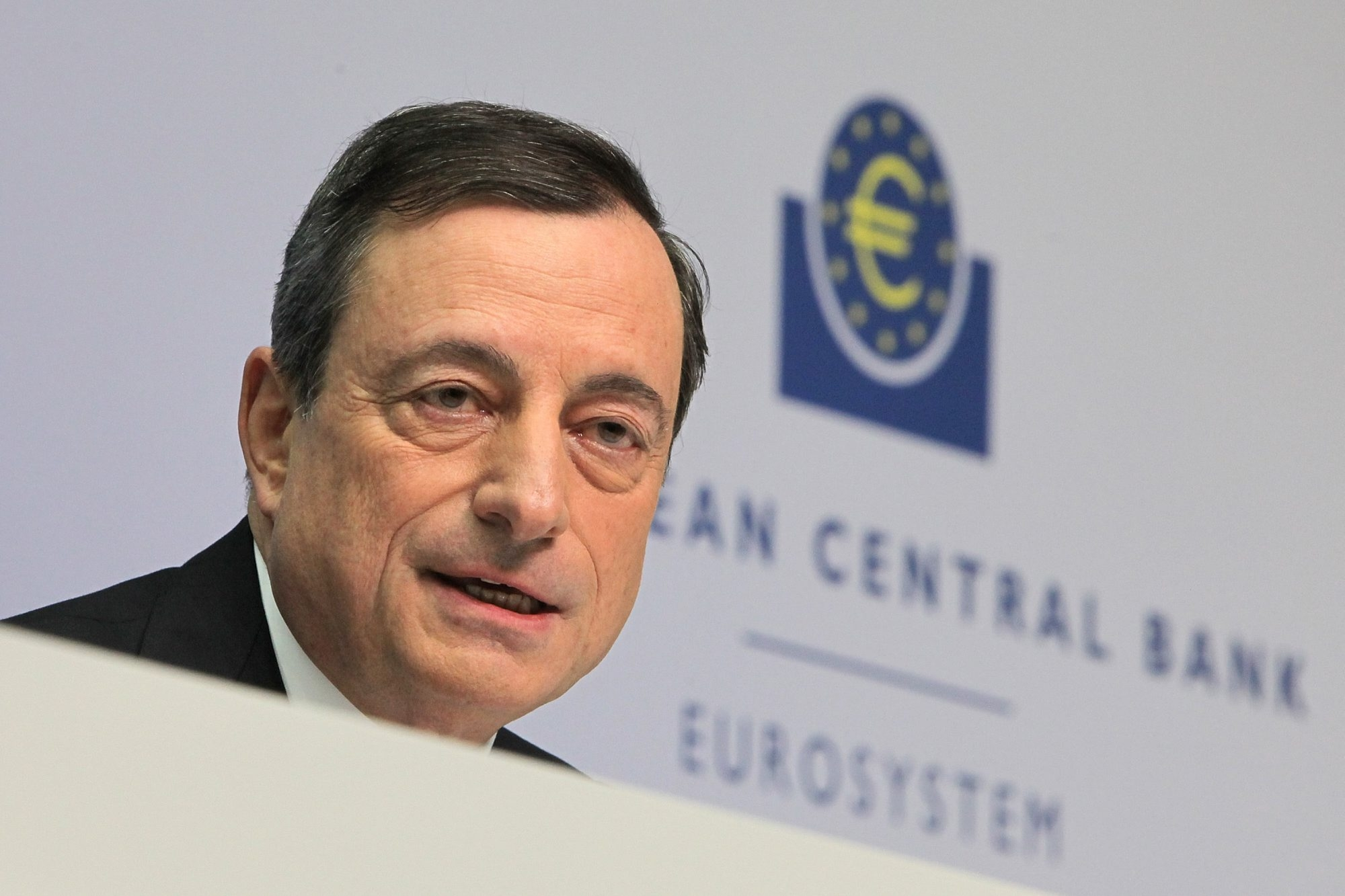 Mario Draghi, head of the European Central Bank, speaks to journalists following a meeting of the ECB governing board. The central bank announced an expanded stimulus program to counter the threat of deflation and boost a near-stagnant economy.