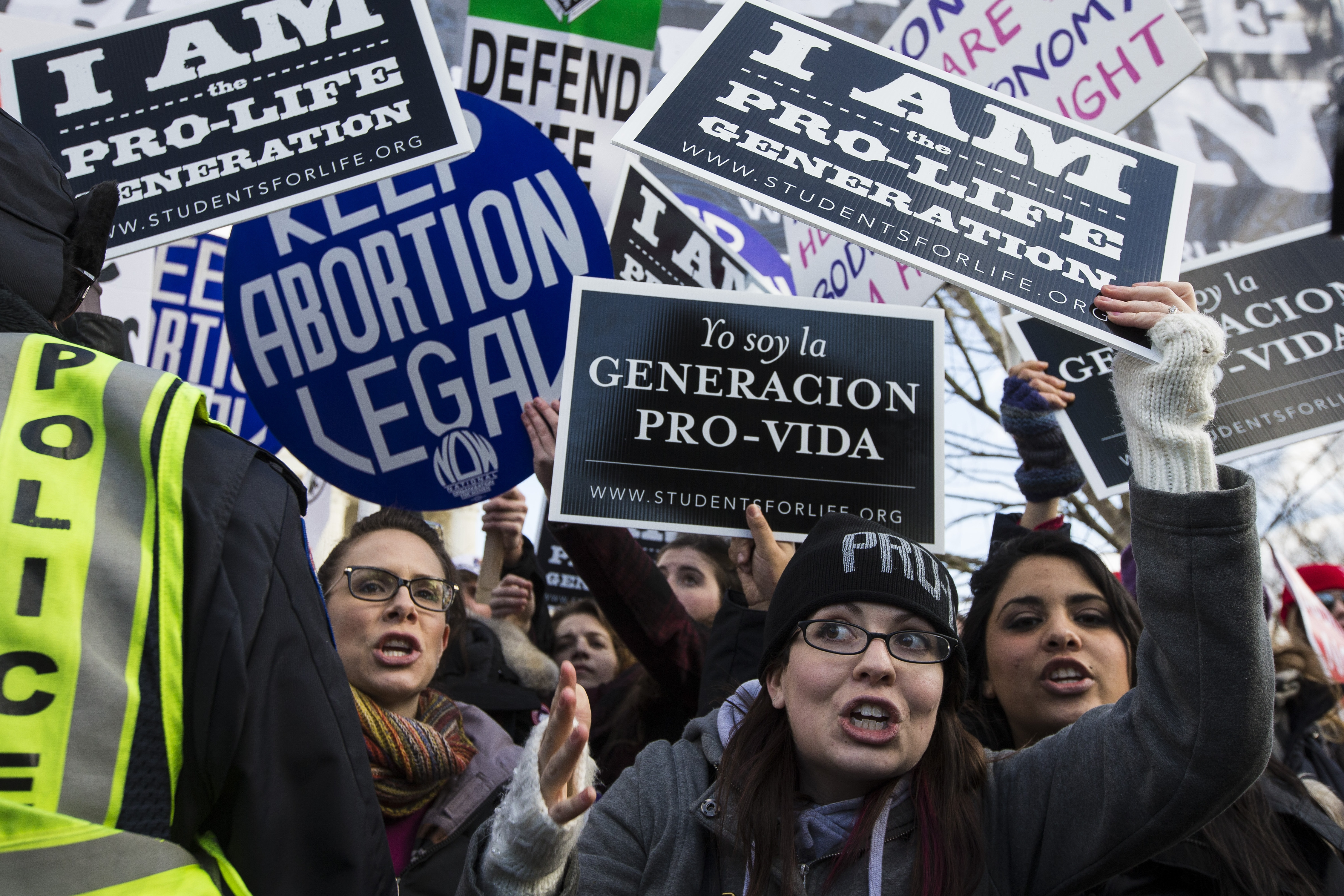 Anti-abortion protesters hold signs in front of the Supreme Court Building during the annual march held on the anniversary of the Roe v. Wade decision in Washington, D.C.
