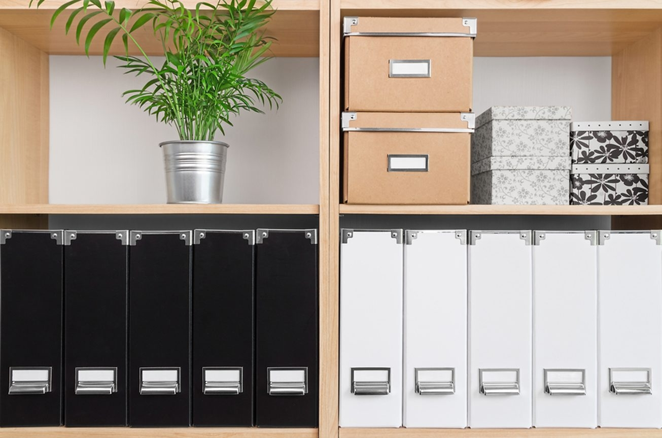 While bins can come in handy, hiding your stuff to make a space look neat is not organizing. Try paring down.