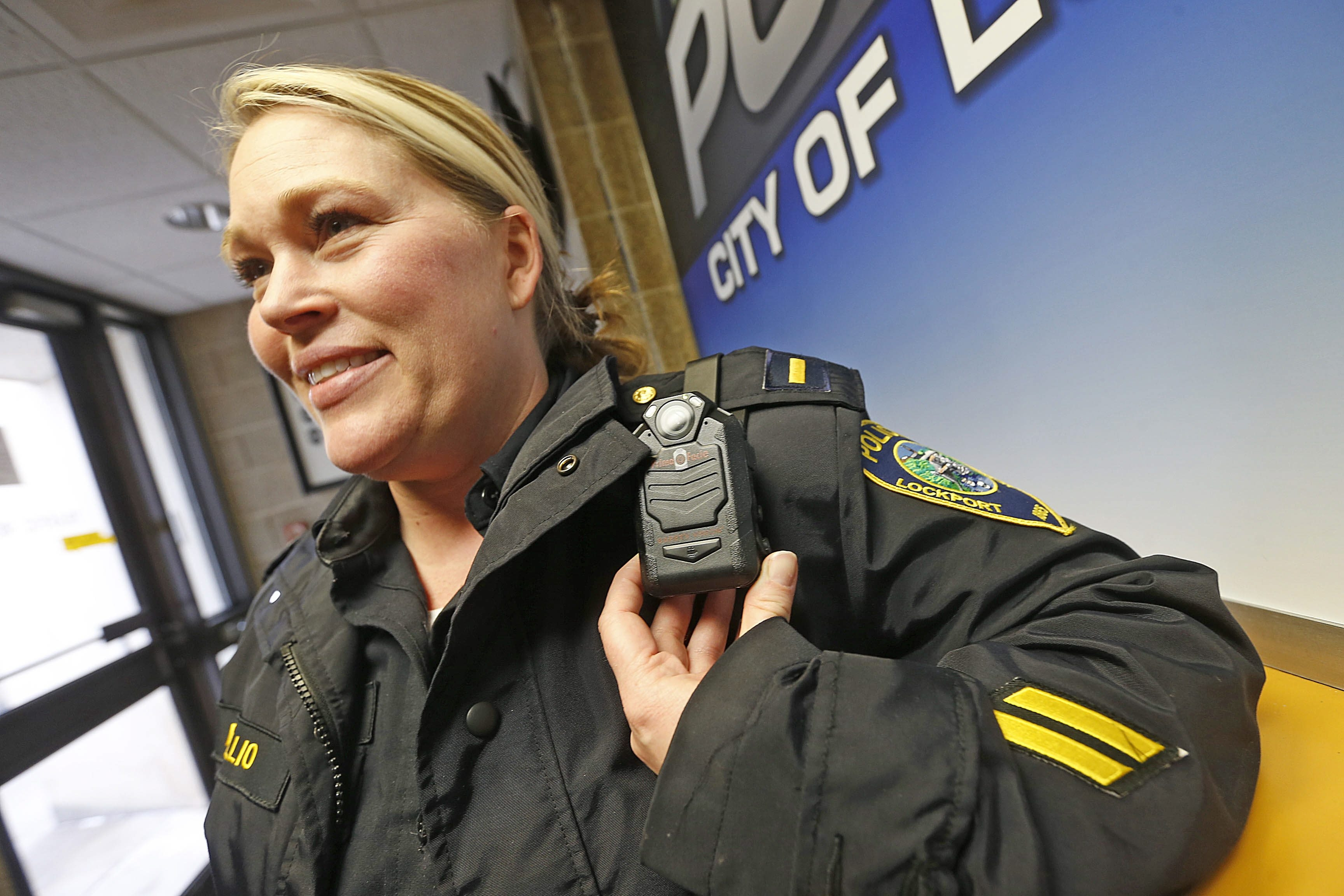 Lockport Police Squad Lt. Kendra DiTullio displays one of the department's new police body cameras, which will soon be standard issue. Lockport is one of several agencies in the county using or planning to use the new technology.